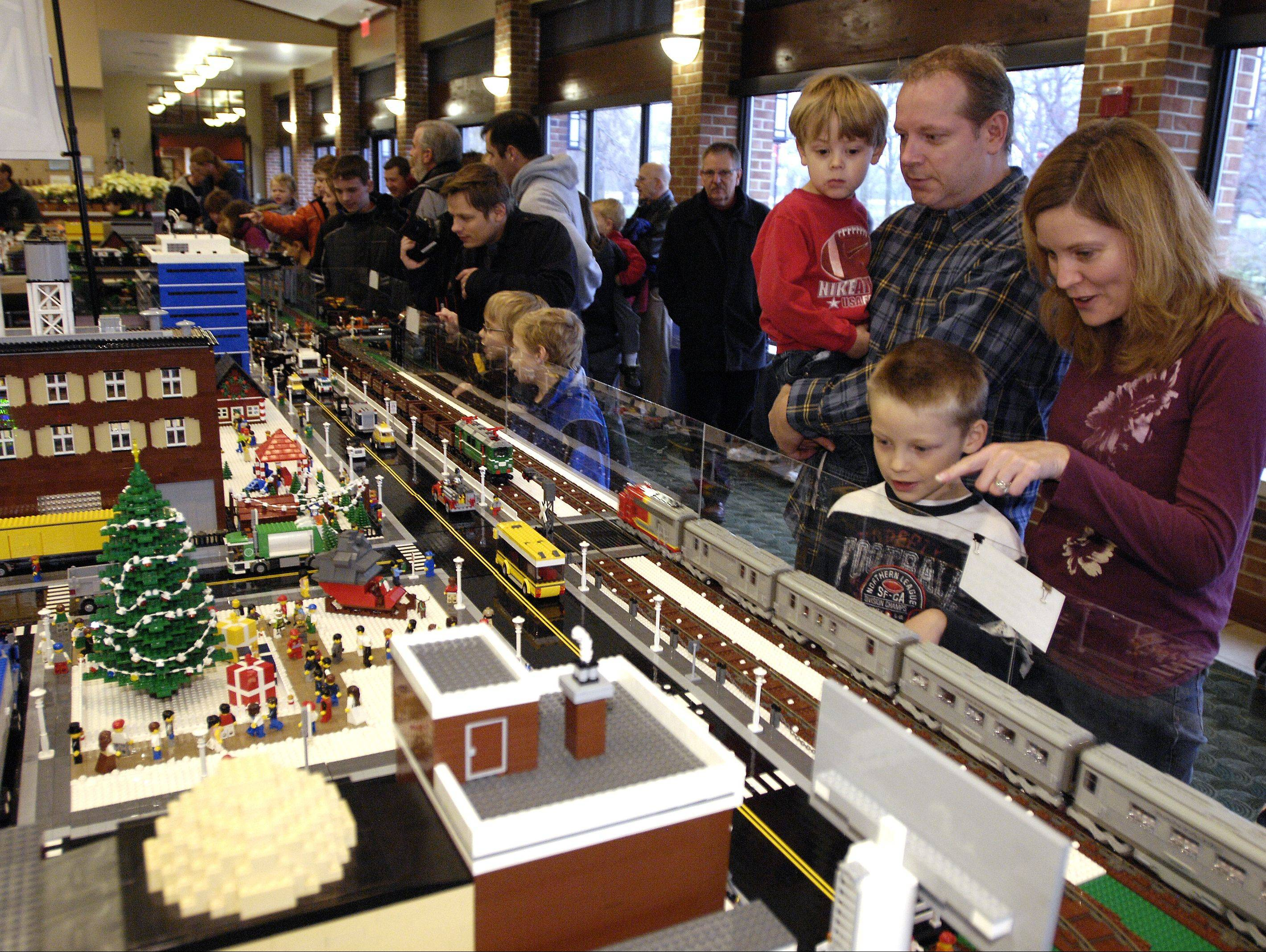 The Komro family, Tony, Becky, Wyatt, 4, and Kyle, 7, check out the displays Sunday at Cantigny Park's annual Holiday Lego Train Show in Wheaton.