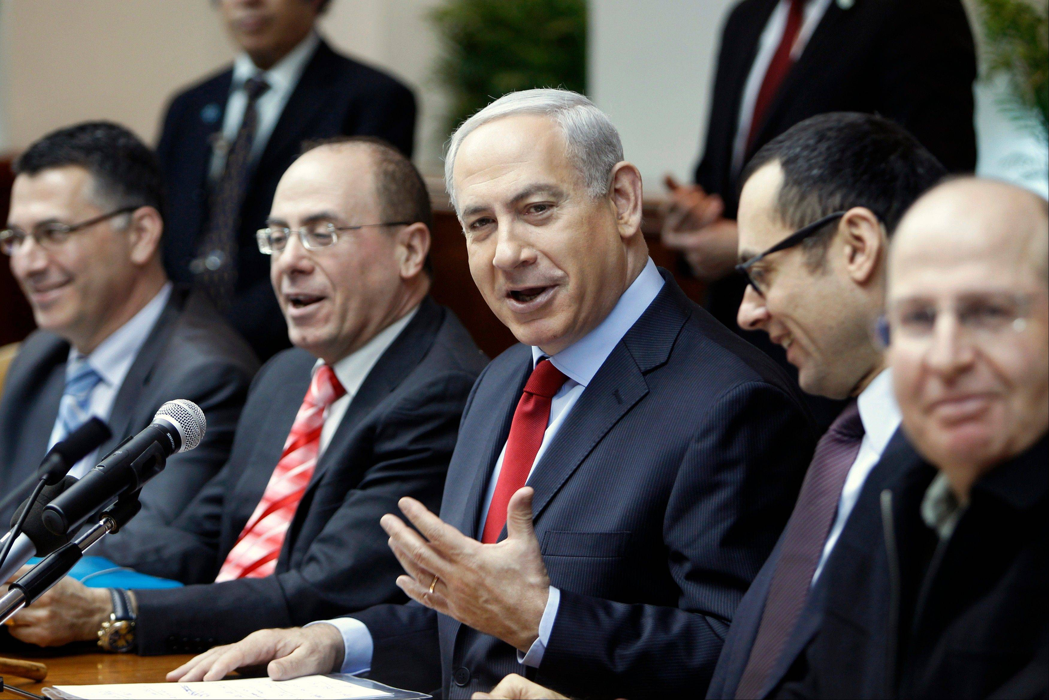 Israeli Prime Minister Benjamin Netanyahu, center, speaks during the weekly Cabinet meeting in his Jerusalem office Sunday.