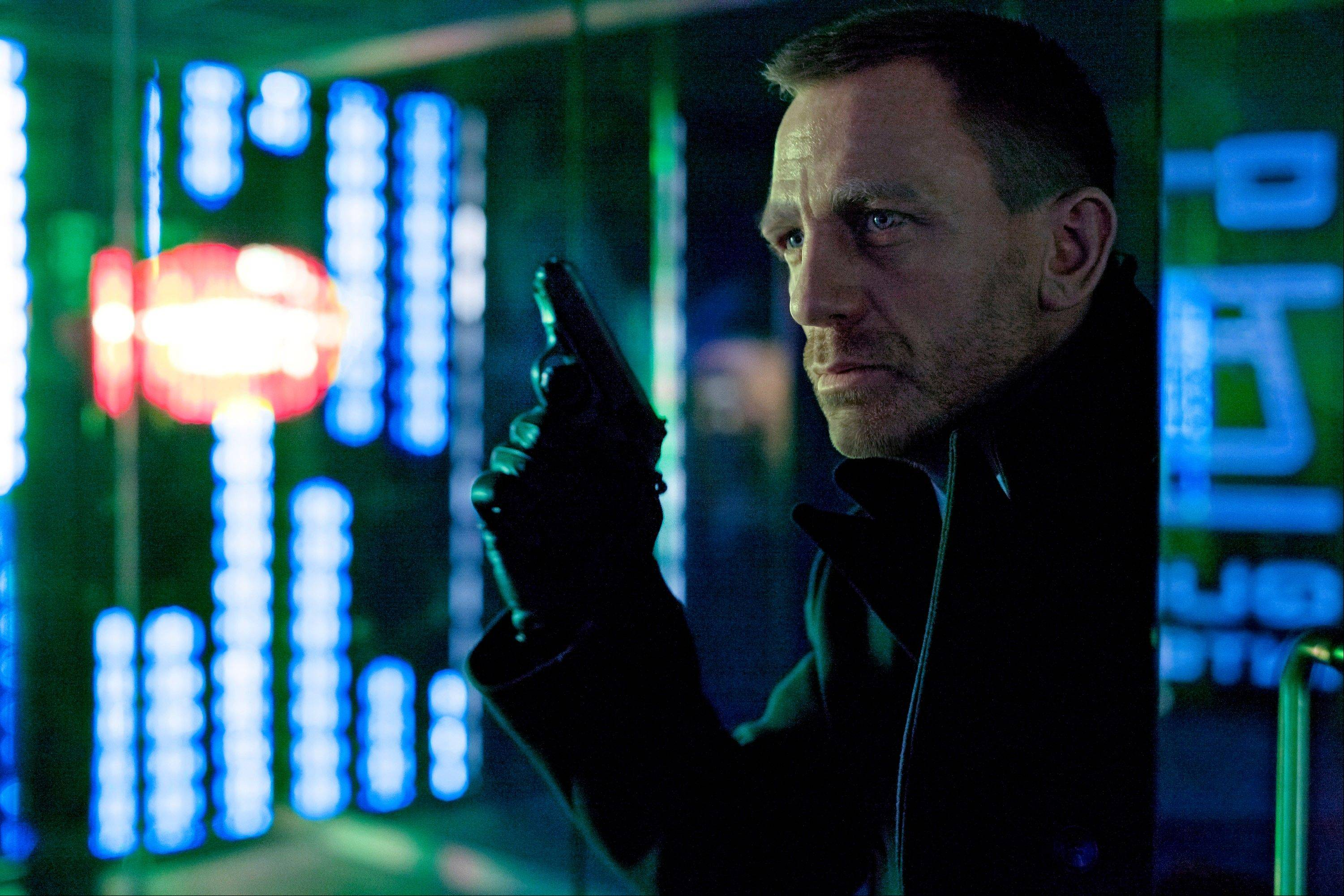 "This undated file photo released by Columbia Pictures shows Daniel Craig as James Bond in the action adventure film, ""Skyfall."" According to studio estimates Sunday, Dec. 9, 2012, ""Skyfall"" took in $11 million to move back to No. 1 in its fifth weekend. That puts it narrowly ahead of ""Rise of the Guardians,"" the animated adventure of Santa, the Easter Bunny and other mythological heroes that pulled in $10.5 million."