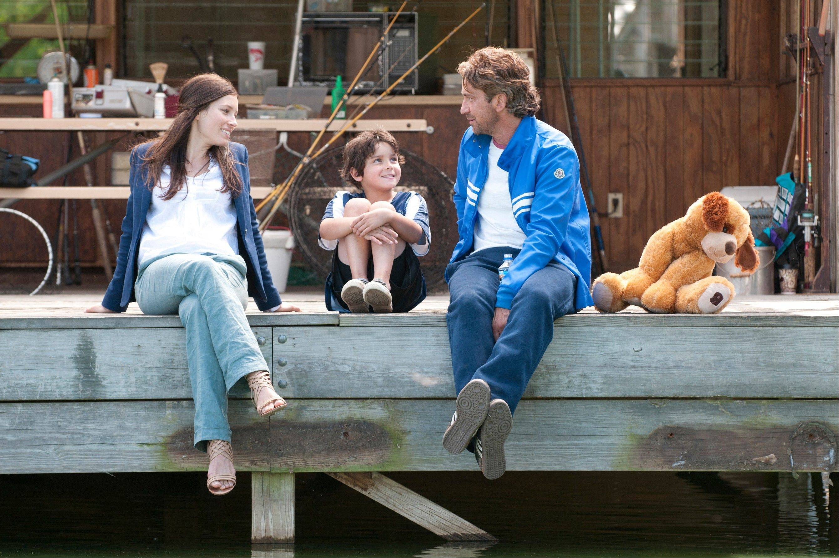 "Jessica Biel and Gerard Butler, along with Noah Lomax, center, star in the romantic comedy sports comedy ""Playing for Keeps,"" which bombed at the box office in its first weekend in release."