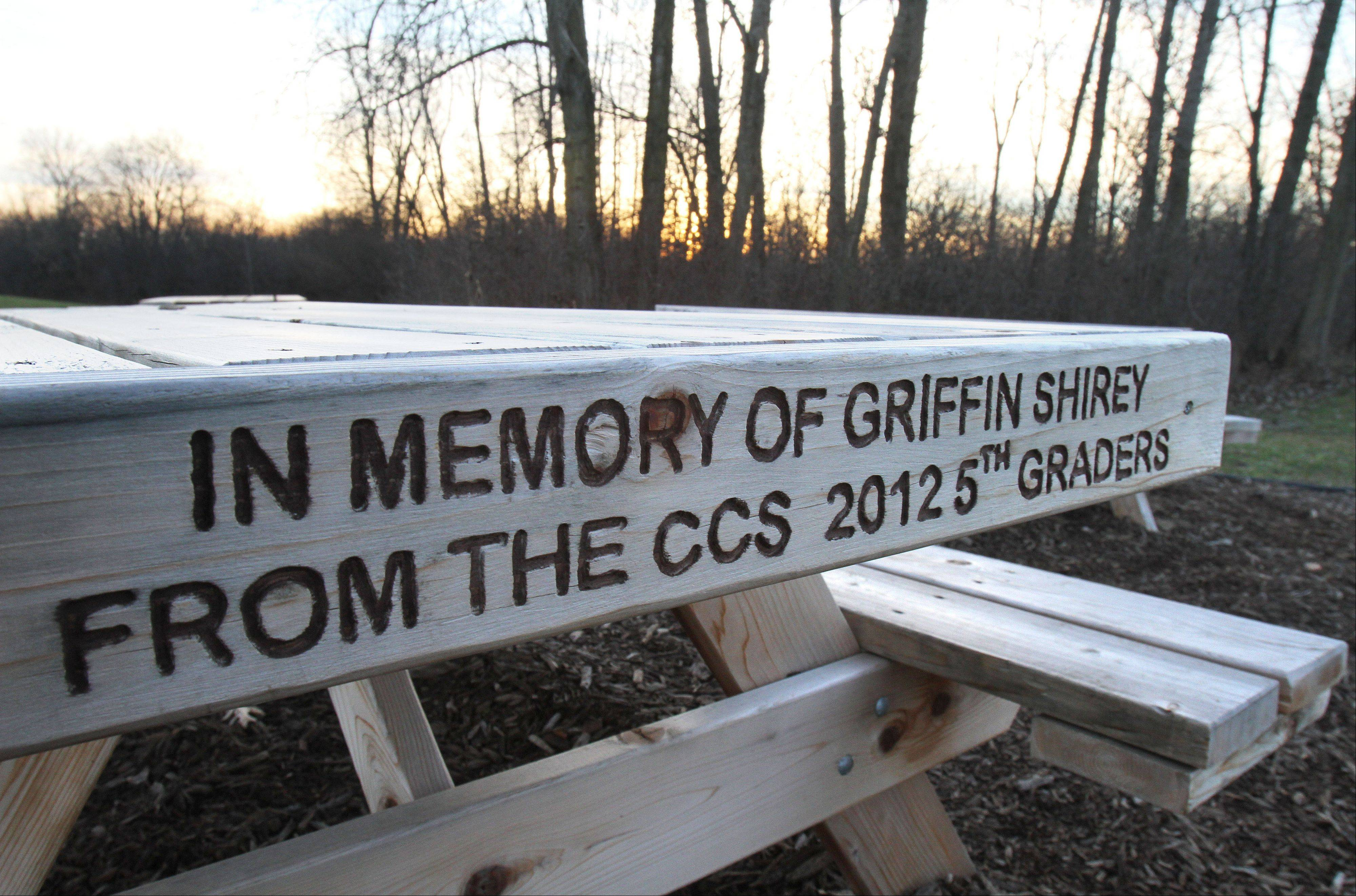 The fifth-grade class at Cotton Creek School in Island Lake donated a picnic bench in memory of Griffin Shirey, who was killed last year in a car crash. The bench sits behind the school.