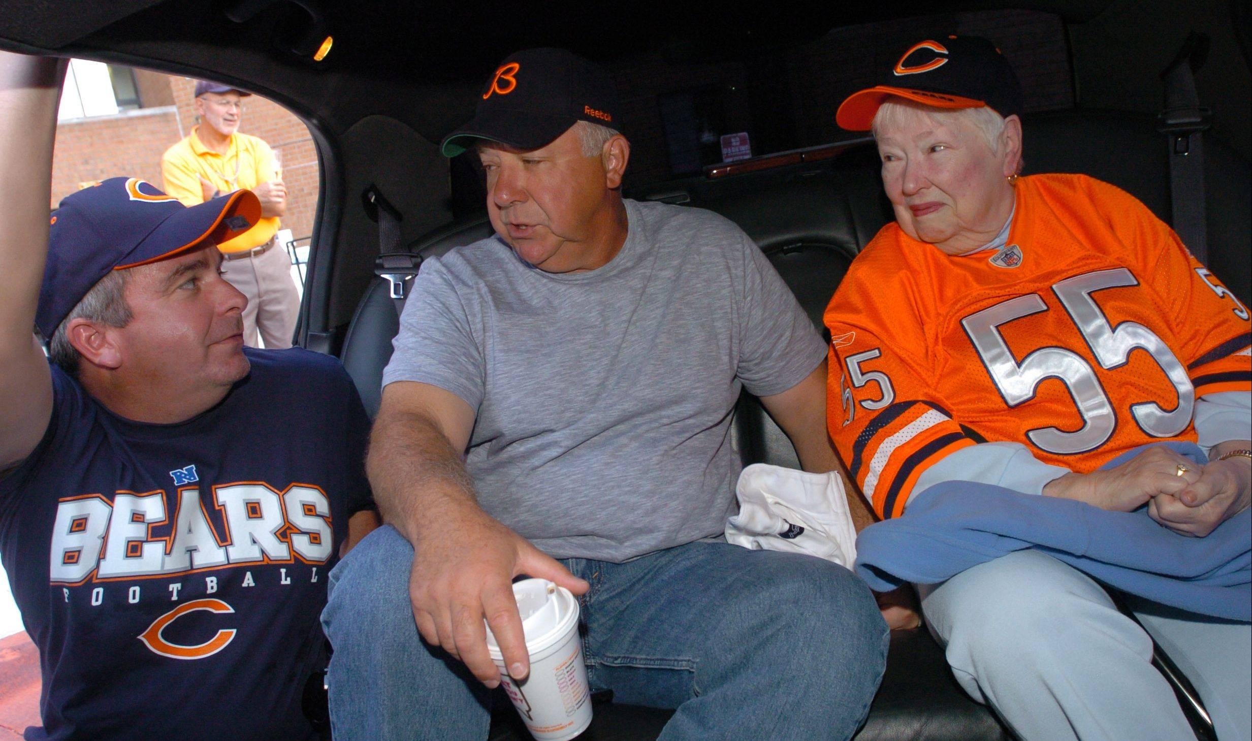 This fall, Bensenville's Golden Wishes program sent Jim and Lauri Collins, along with Betty Madland and her son, George, to attend a Chicago Bears game. Village President Frank Soto, left, saw the Madlands off to the game in a limo.