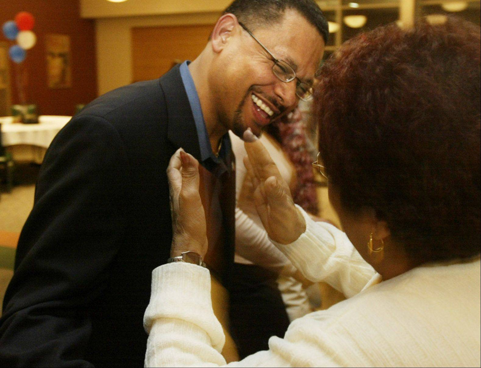 Then-Elgin councilman Juan Figueroa dances with his mother-in-law, Ada Soto of Puerto Rico, during an election night party in 2005. Figueroa was the top vote-getter in that election, but he lost his council bid in 2009. There currently are no Latinos serving on the Elgin City Council, and none filed to run for five open seats in 2013.