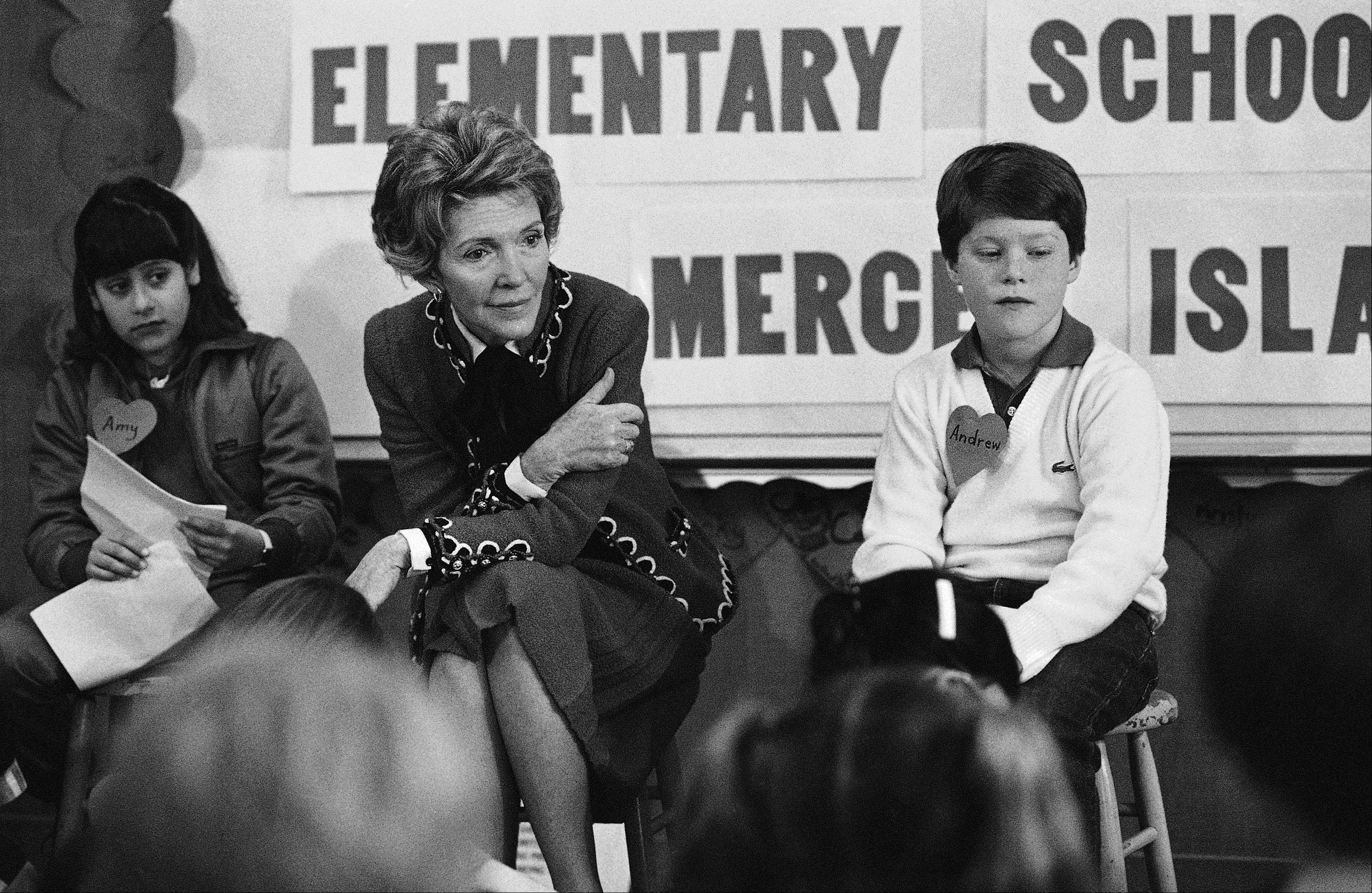 "In 1984, first lady Nancy Reagan sits with a fourth and fifth grade class at Island Park Elementary School on Mercer Island, Wash. where she participated in a drug education class. During a visit with schoolchildren in Oakland, Calif., Reagan later recalled, ""A little girl raised her hand and said, 'Mrs. Reagan, what do you do if somebody offers you drugs?' And I said, 'Well, you just say no.' And there it was born."""