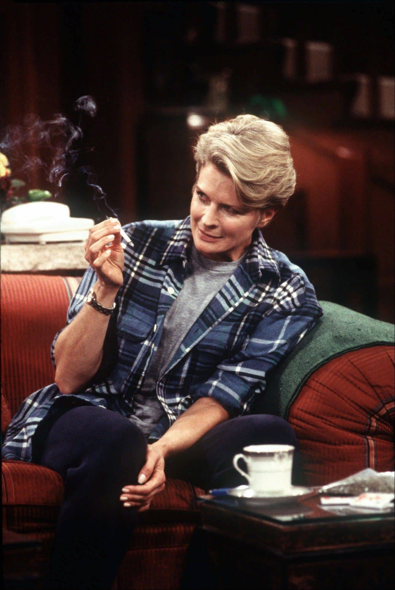 In this 1997 photo, Murphy Brown, portrayed by actress Candice Bergen, smokes a marijuana cigarette to quell nausea induced by the chemotherapy used to treat her breast cancer.
