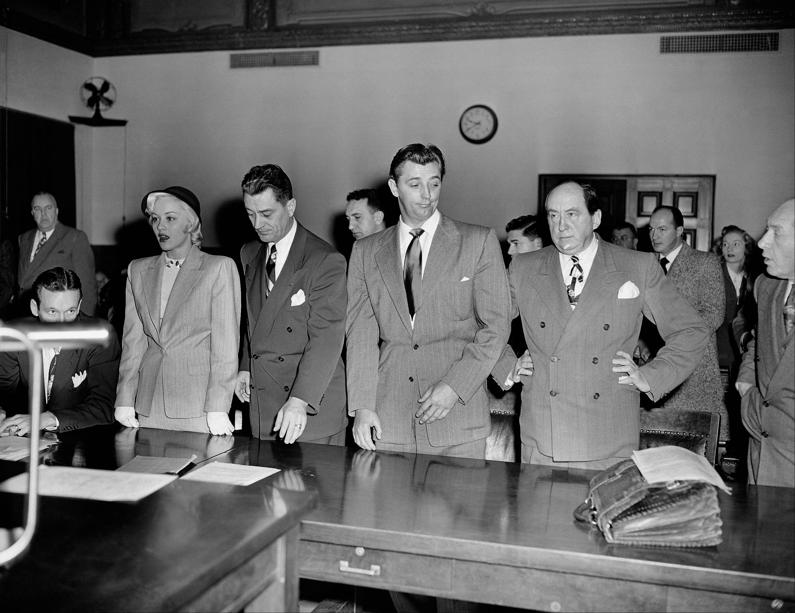 In 1949 actor Robert Mitchum, center right, and actress Lila Leeds, left, were sentenced to 60 days in jail on charges of conspiracy to possess marijuana cigarettes in Los Angeles.
