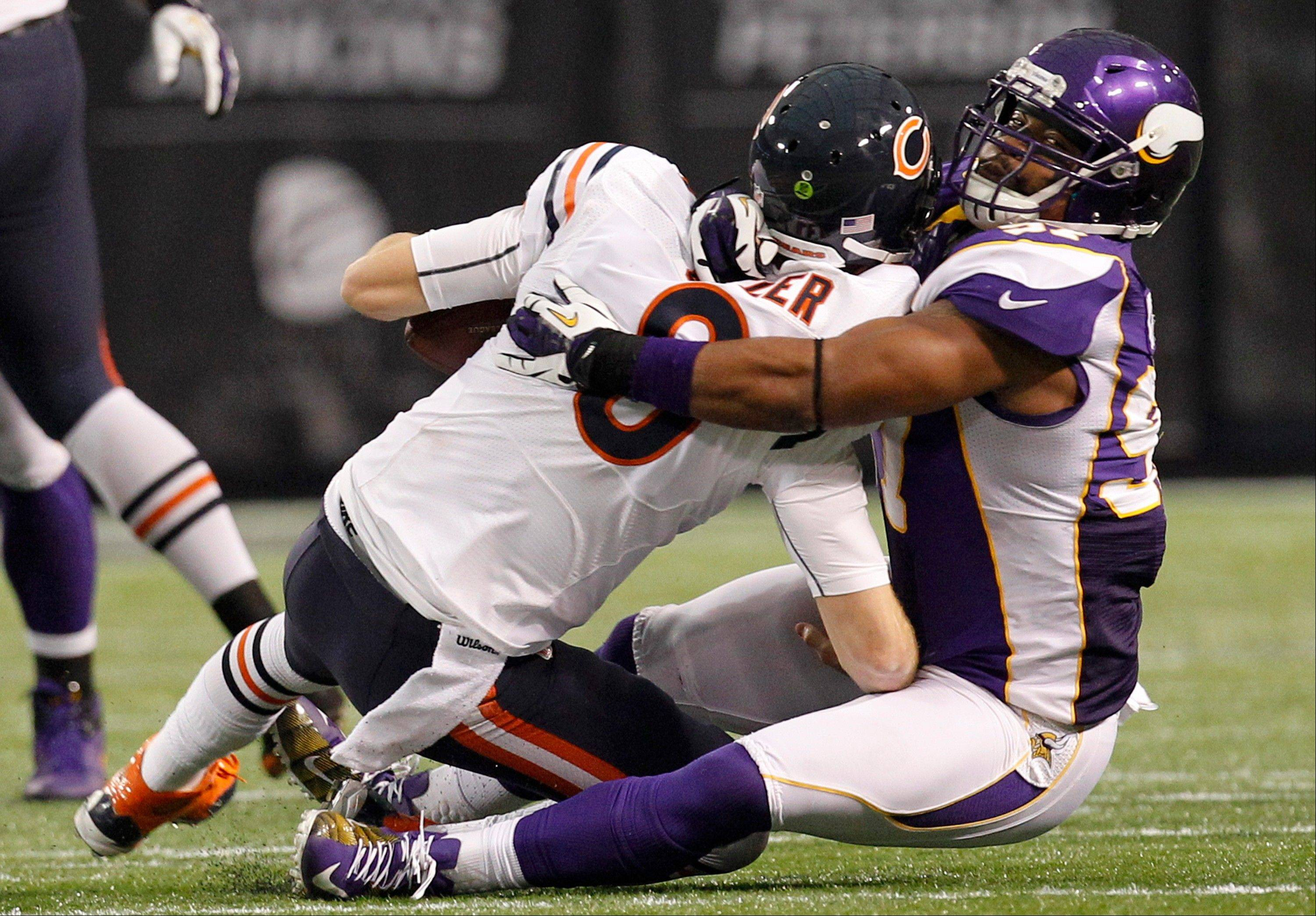 Minnesota Vikings defensive end Everson Griffen, right, sacks Chicago Bears quarterback Jay Cutler during the first half.