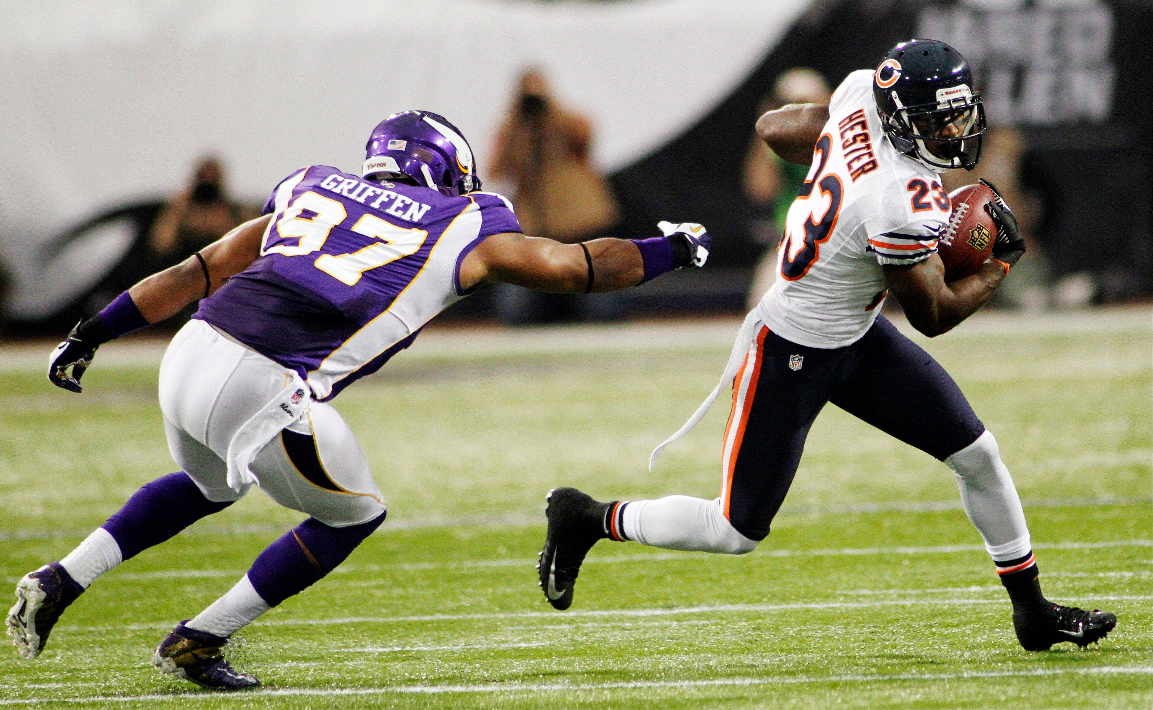 Chicago Bears wide receiver Devin Hester runs from Minnesota Vikings defensive end Everson Griffen during the first half.