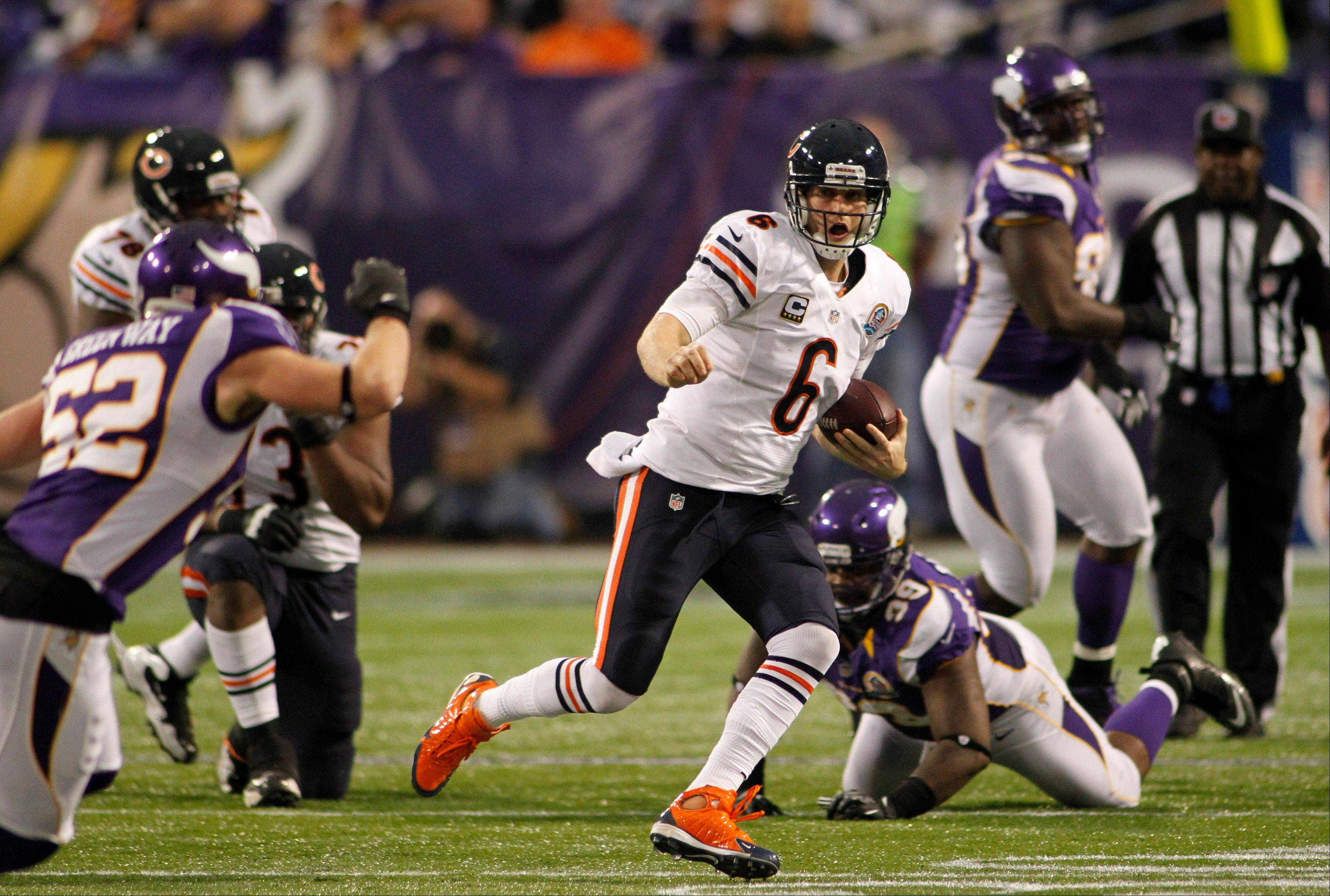 Chicago Bears quarterback Jay Cutler scrambles during the second half of a game against the Minnesota Vikings.