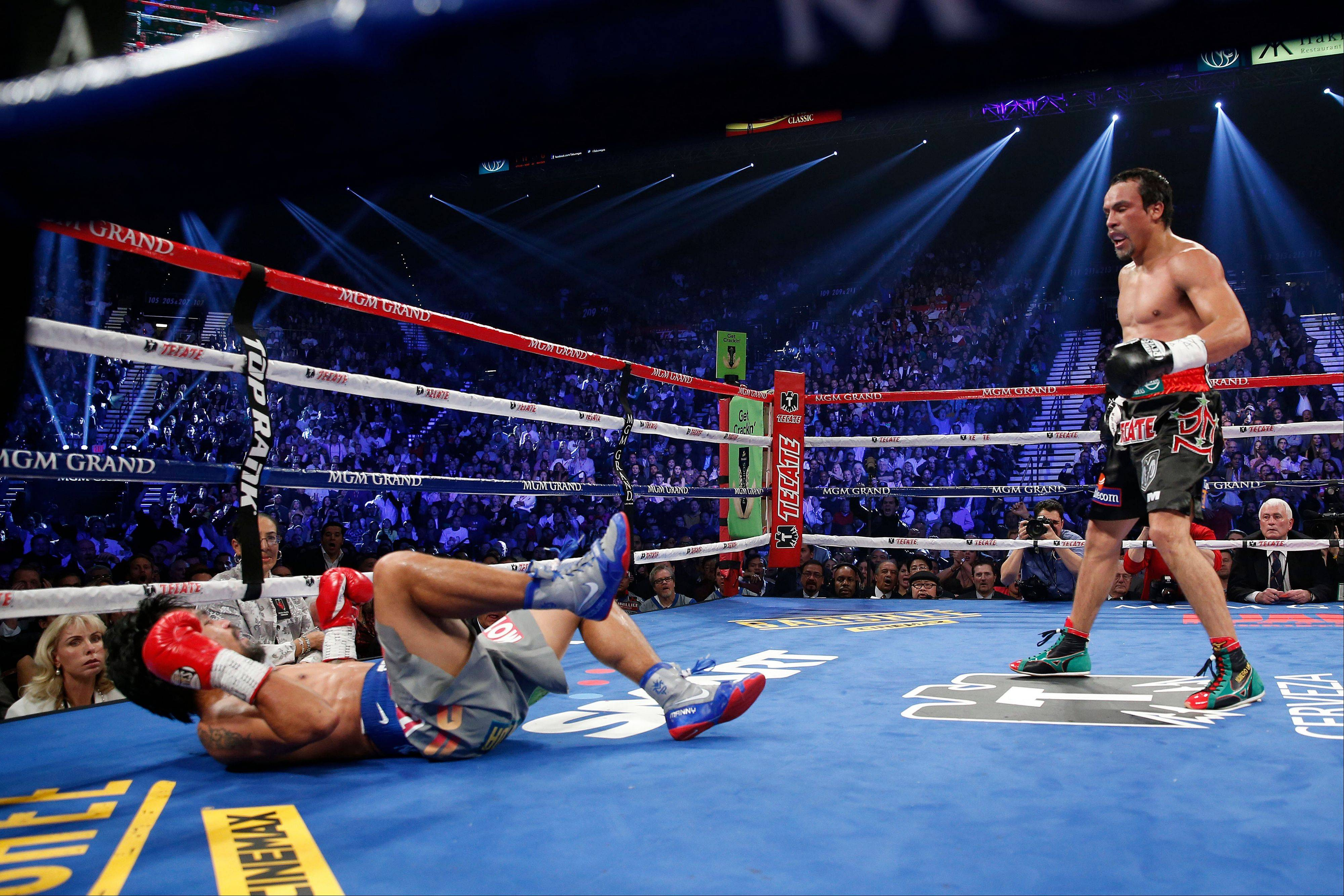 Juan Manuel Marquez, left, knocks down Manny Pacquiao in the third round.