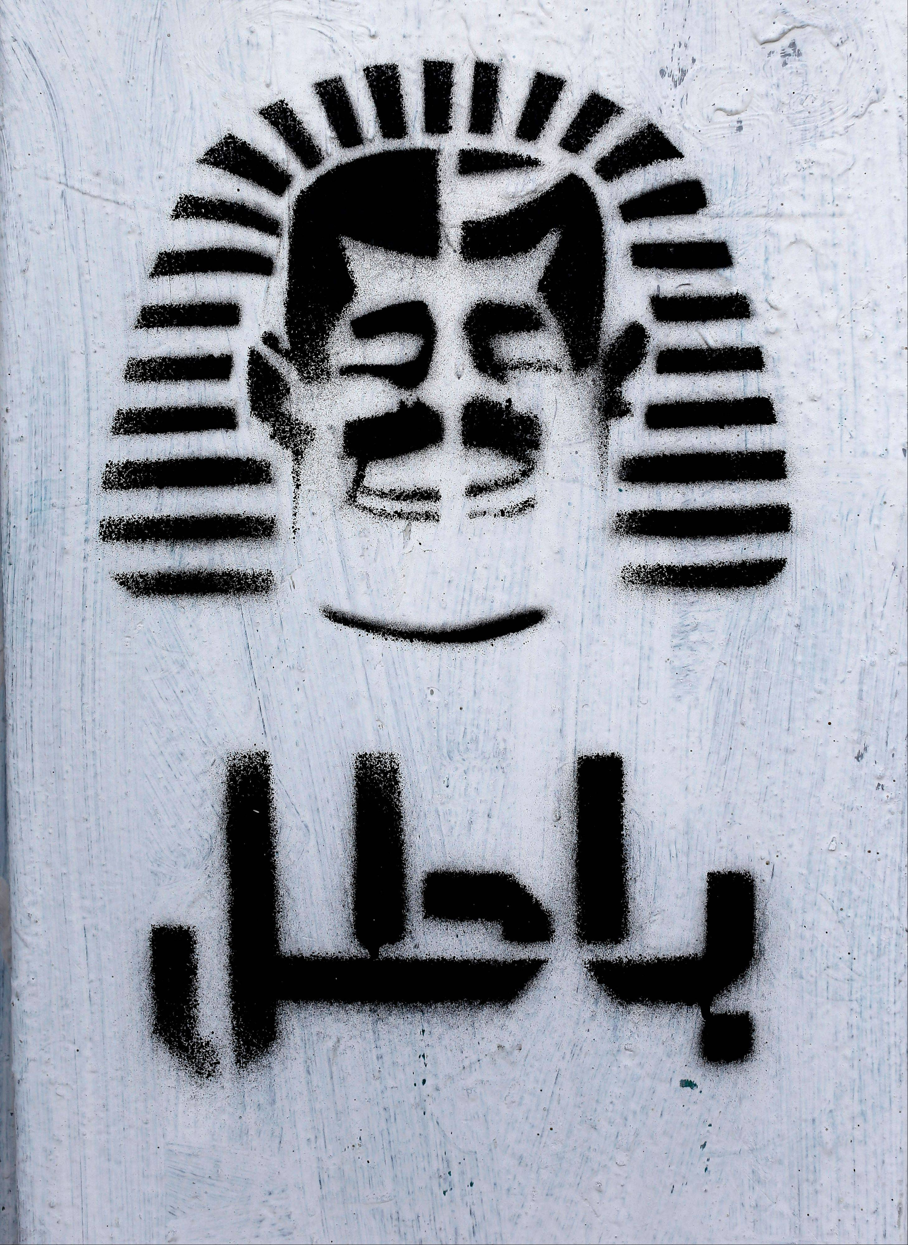 Graffiti depicting Egyptian President Mohammed Morsi as a pharaoh and Arabic that reads, �void,� covers a wall in Tahrir Square in Cairo on Monday.