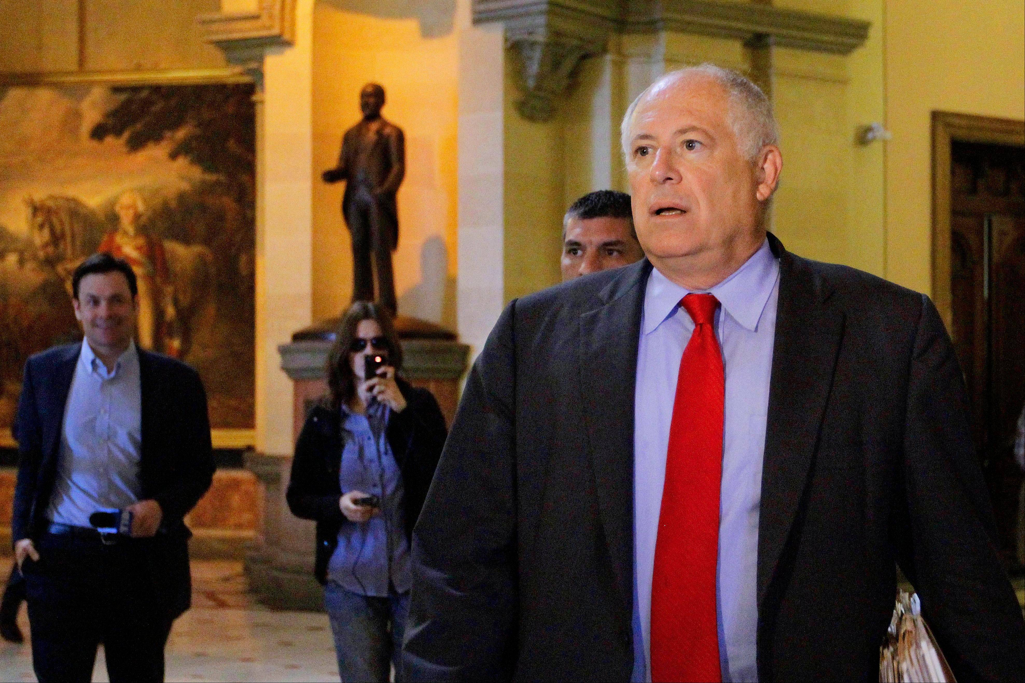 "Illinois Gov. Pat Quinn heads into a meeting with legislative leaders to discuss a state pension overhaul at the Illinois State Capitol back in August. Experts who run numbers estimate a $1 billion cost to Illinois in lost federal revenue if President Barack Obama and Congress cannot reach a budget agreement and allow the economy to plunge off the so-called ""fiscal cliff."""