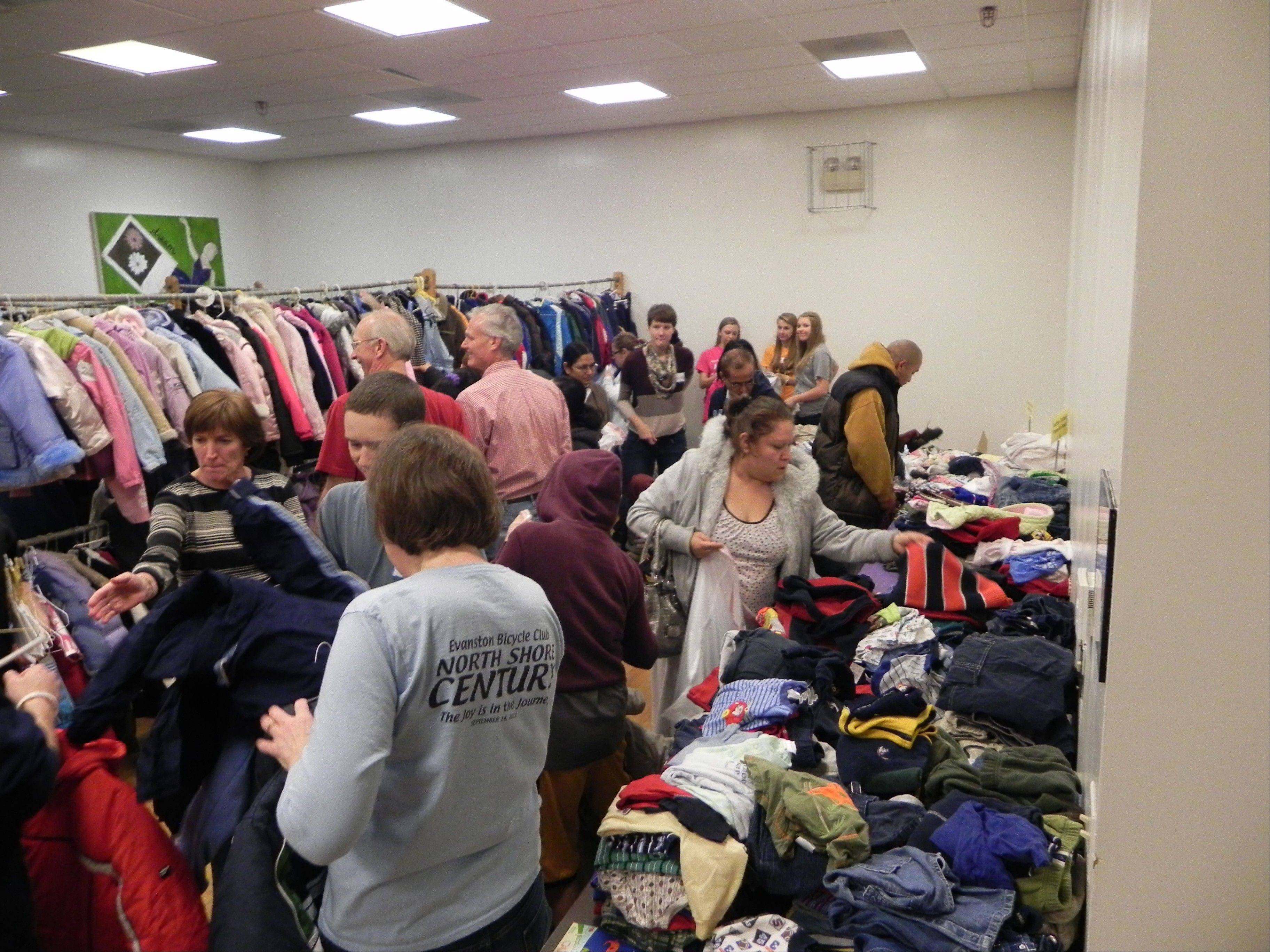 Volunteers sort and organize the massive amounts of clothing they collected for this year's Day of Giving.