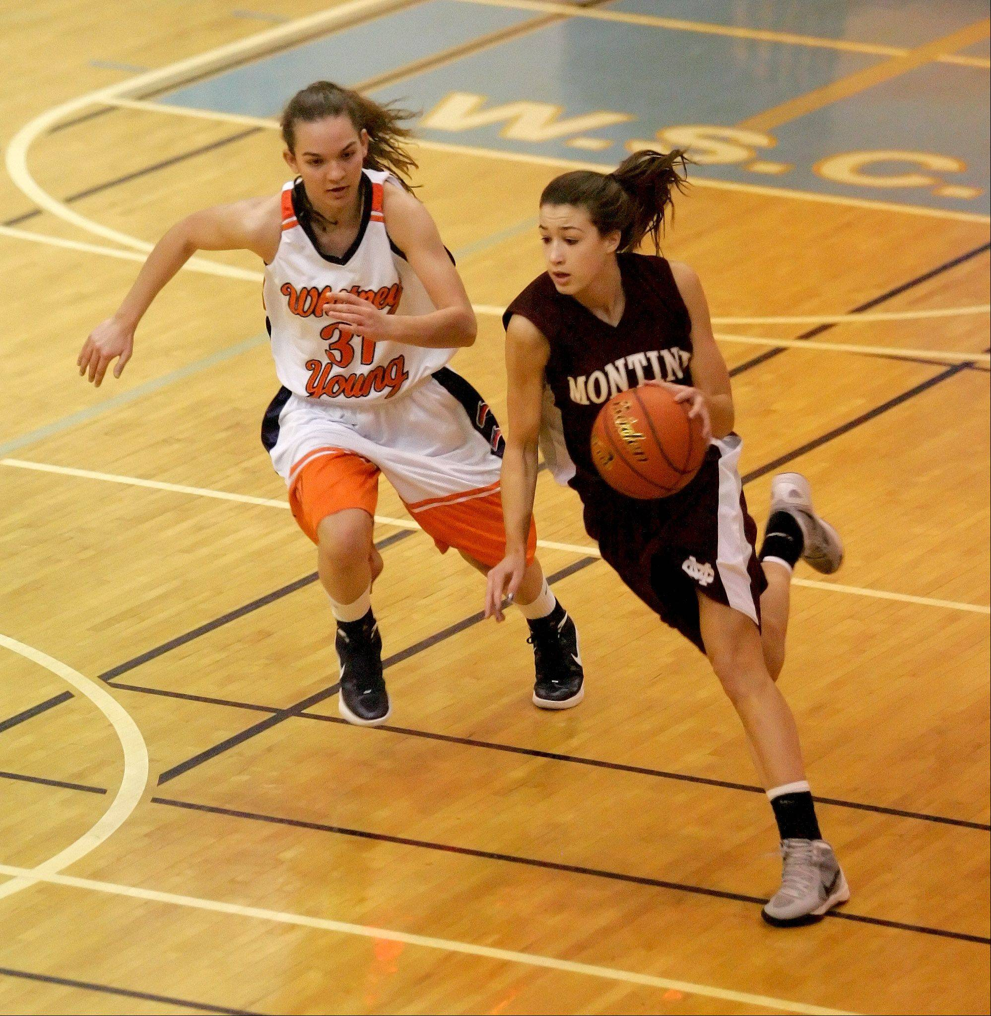 Kelsey Bogdan of Montini drives around Tessa Haldes of Whitney Young in girls basketball action at the McDonald�s Shootout Monday at Willowbrook High School in Villa Park.