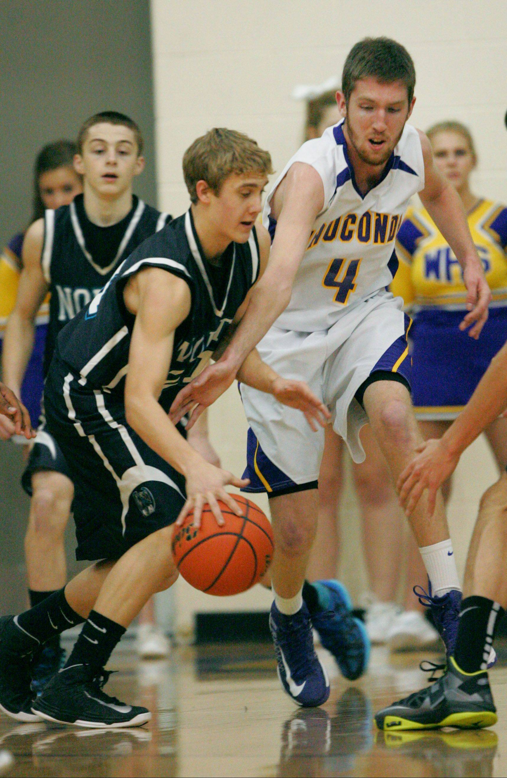 Wauconda�s Ricky Sidlowski, right, tries to steal the ball from Woodstock North�s Shane Zieman on Monday at Wauconda.