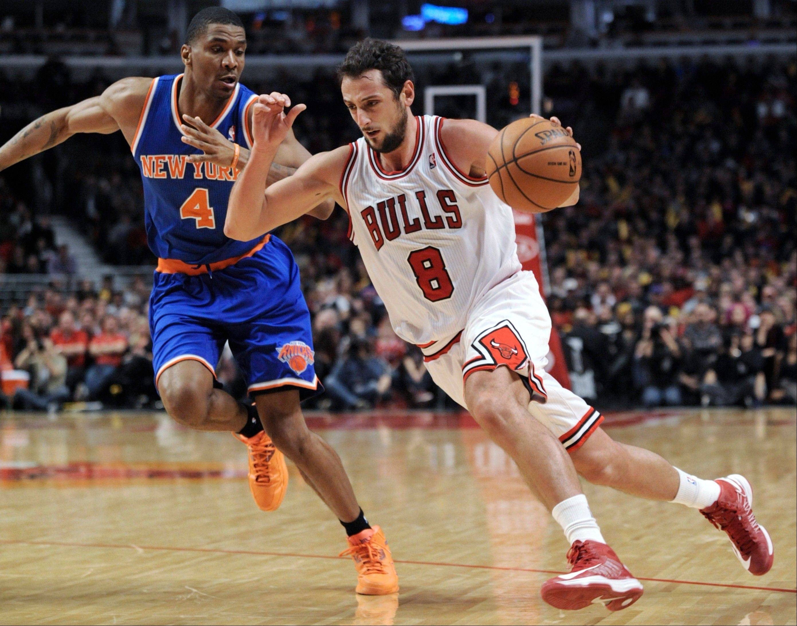 Marco Belinelli drives around the New York Knicks' James White during the fourth quarter of an NBA basketball game in Chicago, Saturday, Dec. 8, 2012. Chicago won 93-85.