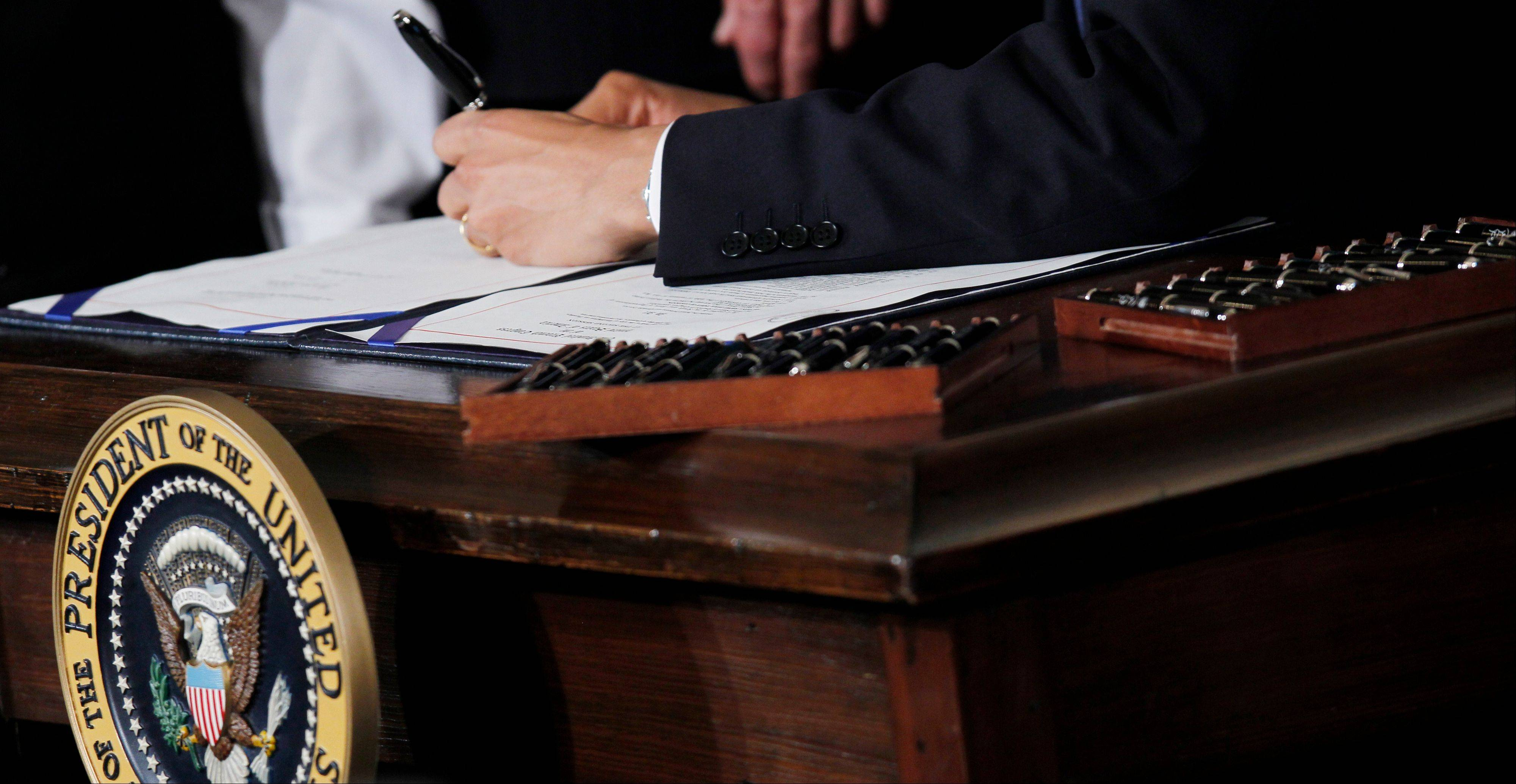 President Barack Obama used 22 pens to signs the health care reform bill at the White House on March 23, 2010. Your medical plan is facing an unexpected expense, so you probably are, too: a new, $63-per-head fee to cushion the cost of covering people with pre-existing conditions under the health overhaul.