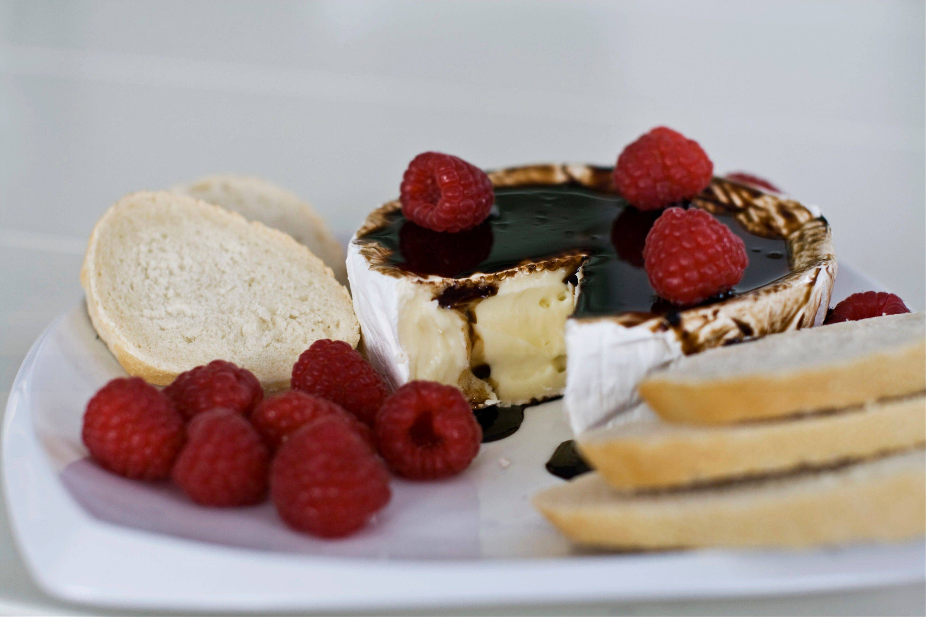 Brie gets into the holiday spirit with a bourbon-balsamic glaze.