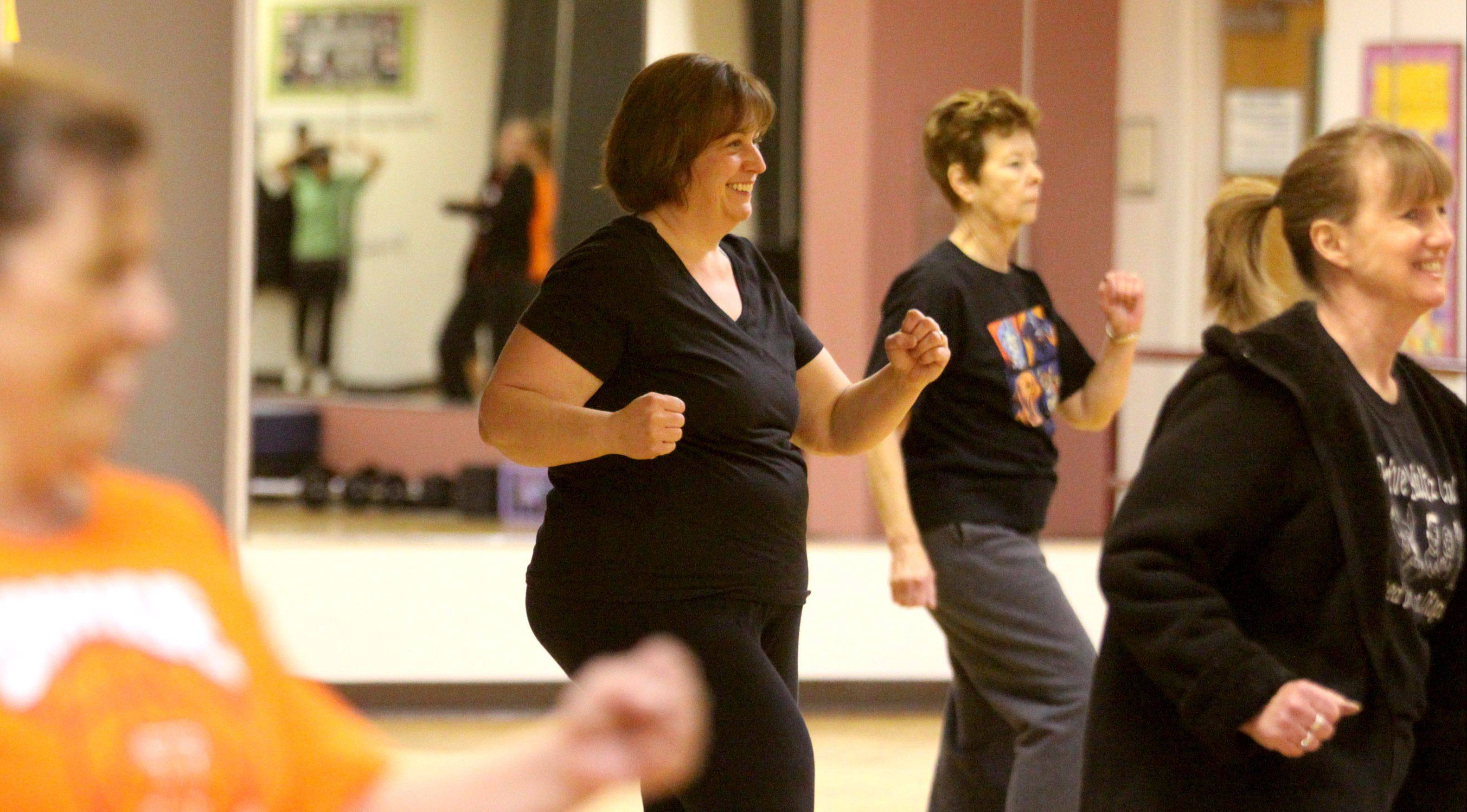 Karen Maranto, center, enjoys a Zumba class taught by Nannette Dukes at the Hanover Park Centre Court Athletic Club.