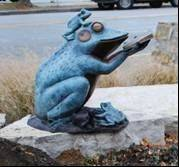 "The Waukegan Public Library received donations from Elaine Manzke Eagon, Ann Hughes-Johnson and R. Vincent Johnson to complete the funding for the sculpture ""Frog Prince Reading Book"" to be installed in the library's Stimson Sculpture Garden."