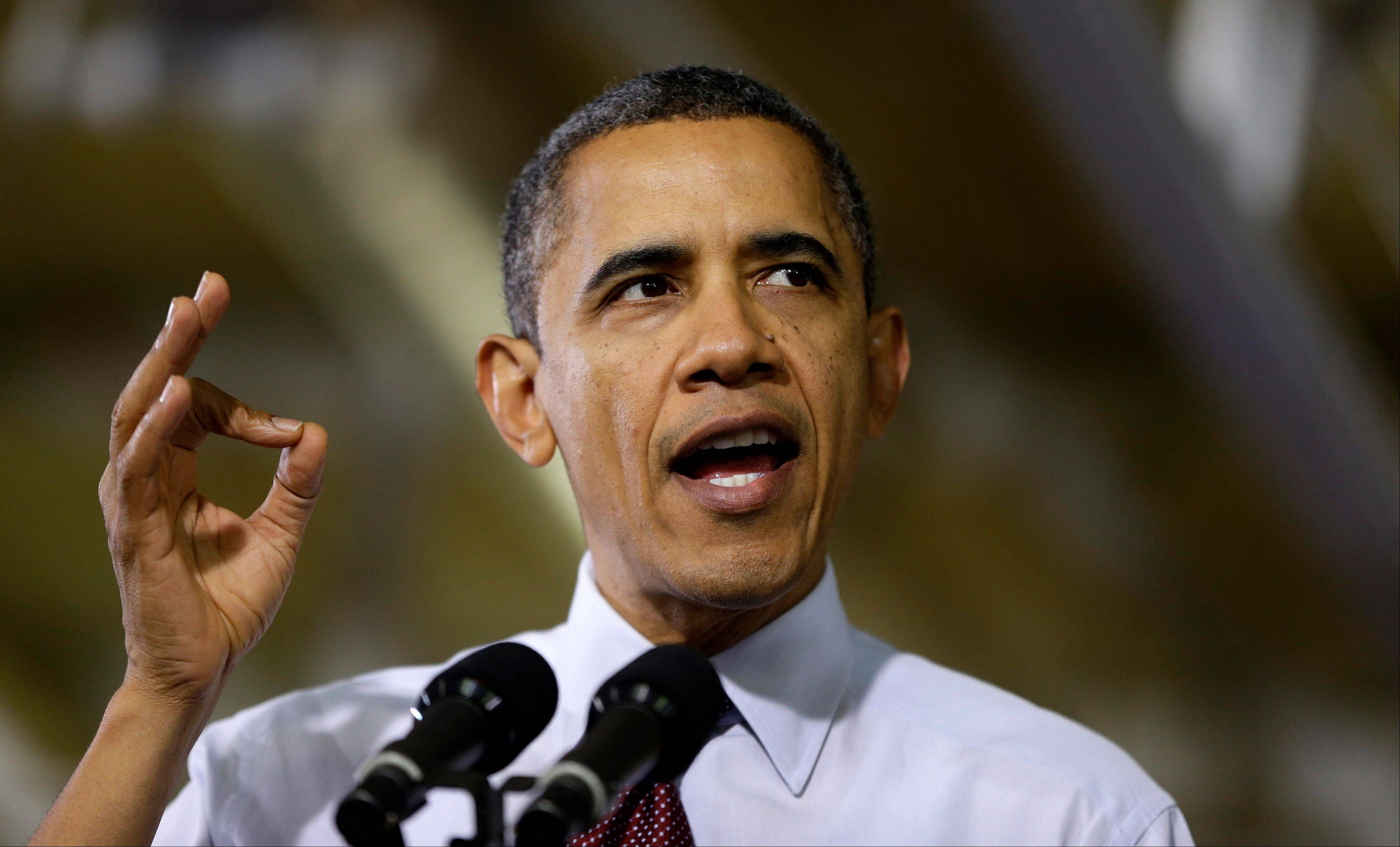 President Barack Obama speaks to workers about the economy during a visit to the Daimler Detroit Diesel plant in Redford, Mich., Monday.