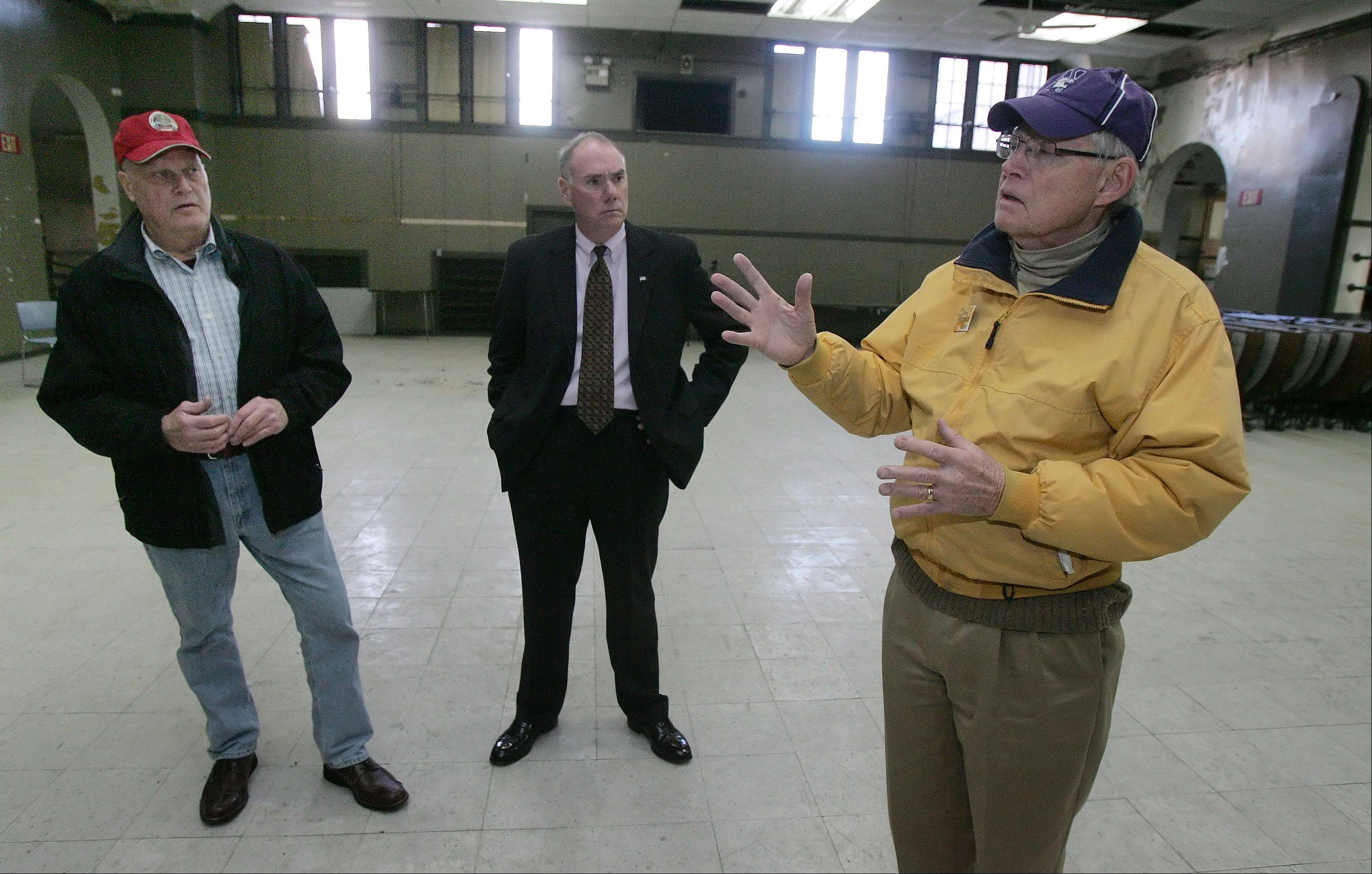 John Snow, right, Scott Adams and Walt Oakley, of the Brainerd Community Center Inc., discuss plans to gauge voter support of a property tax increase to revive the 1916 former high school building for a variety of activities.