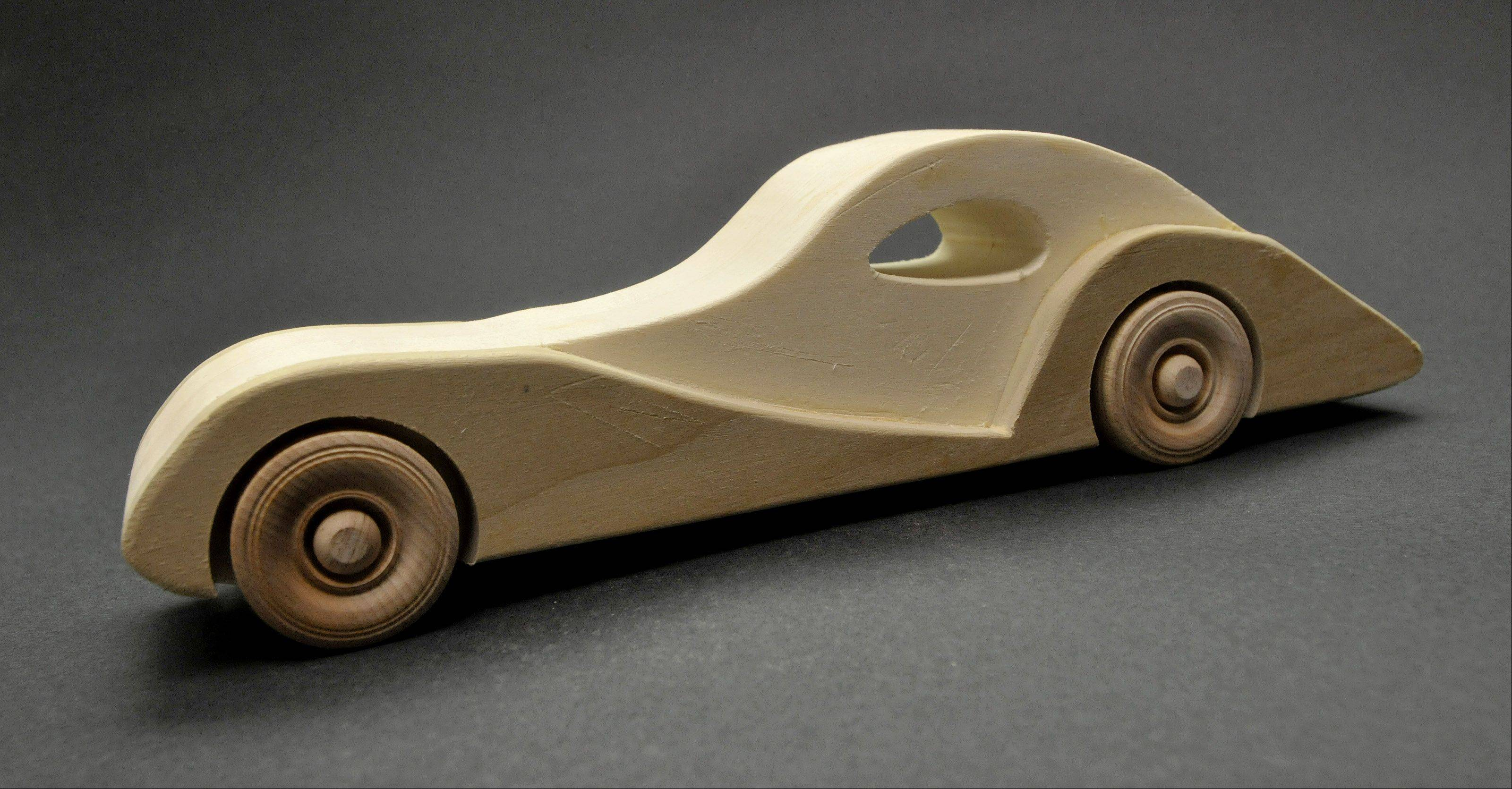 A model Bugatti sports car features a sleek design. The cars and trucks are especially popular among boys.