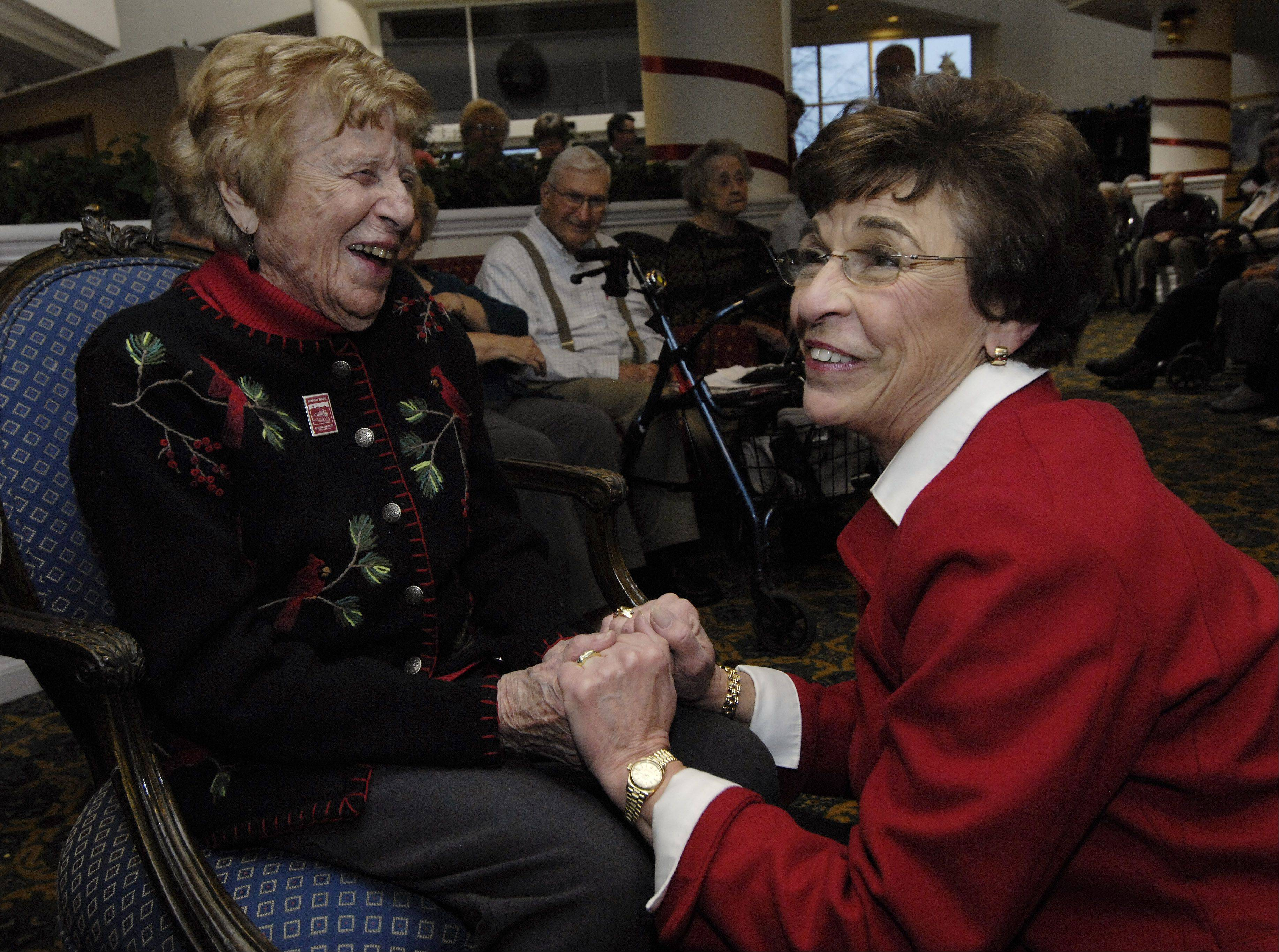 Mayor Arlene Mulder, right, visits with Lois Arbanas as she celebrates her 105th birthday at the Moorings Friday.