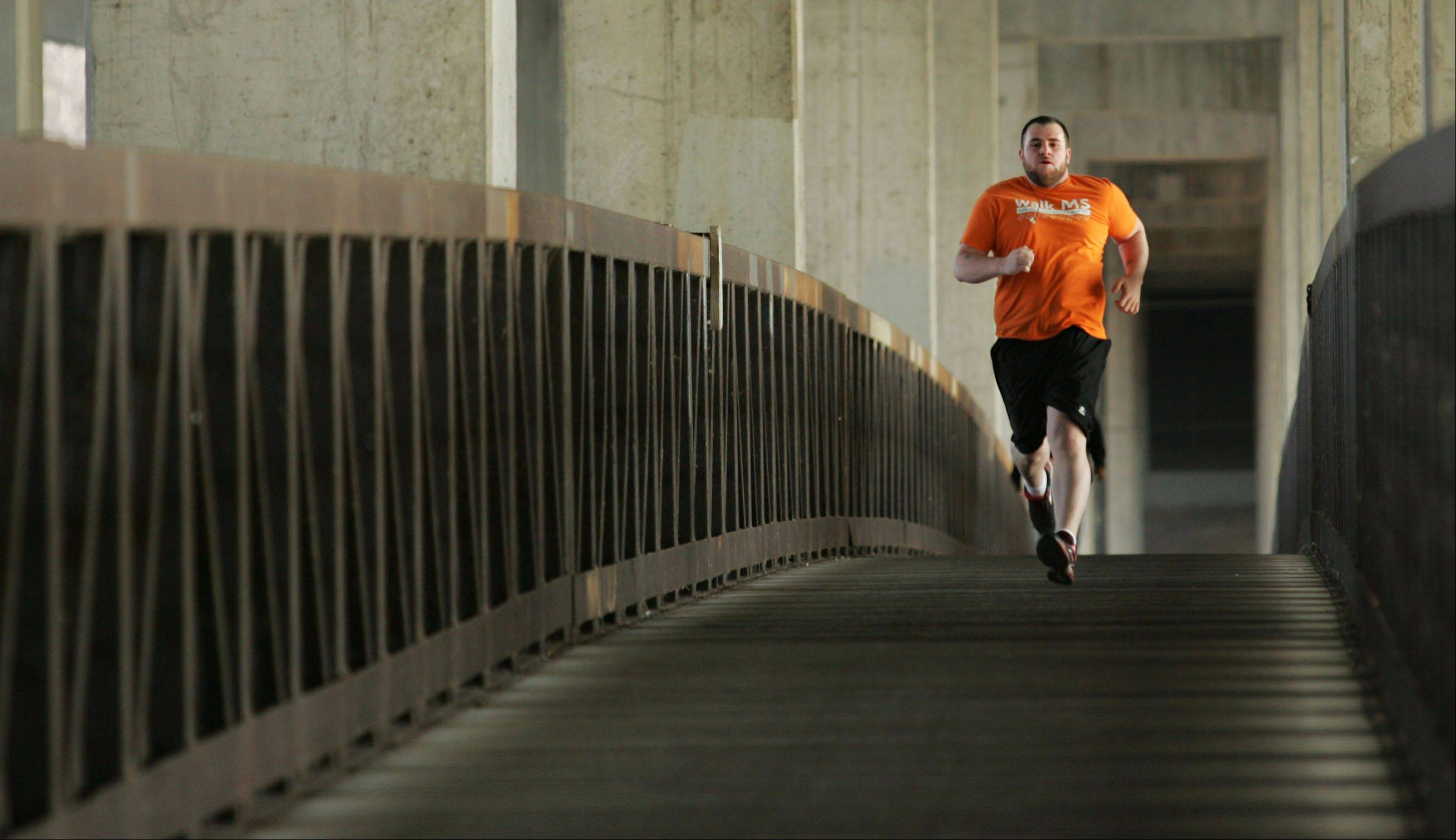 2012 Fittest Loser winner Michael White runs the bridge above the Fox River in Elgin near Voyageurs Landing Forest Preserve.
