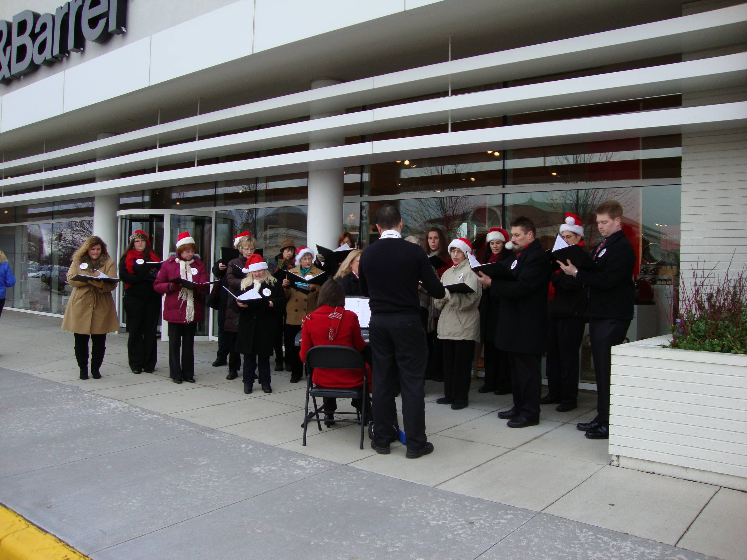 Allegro Adult Choir performing at Deer Park Town Center.