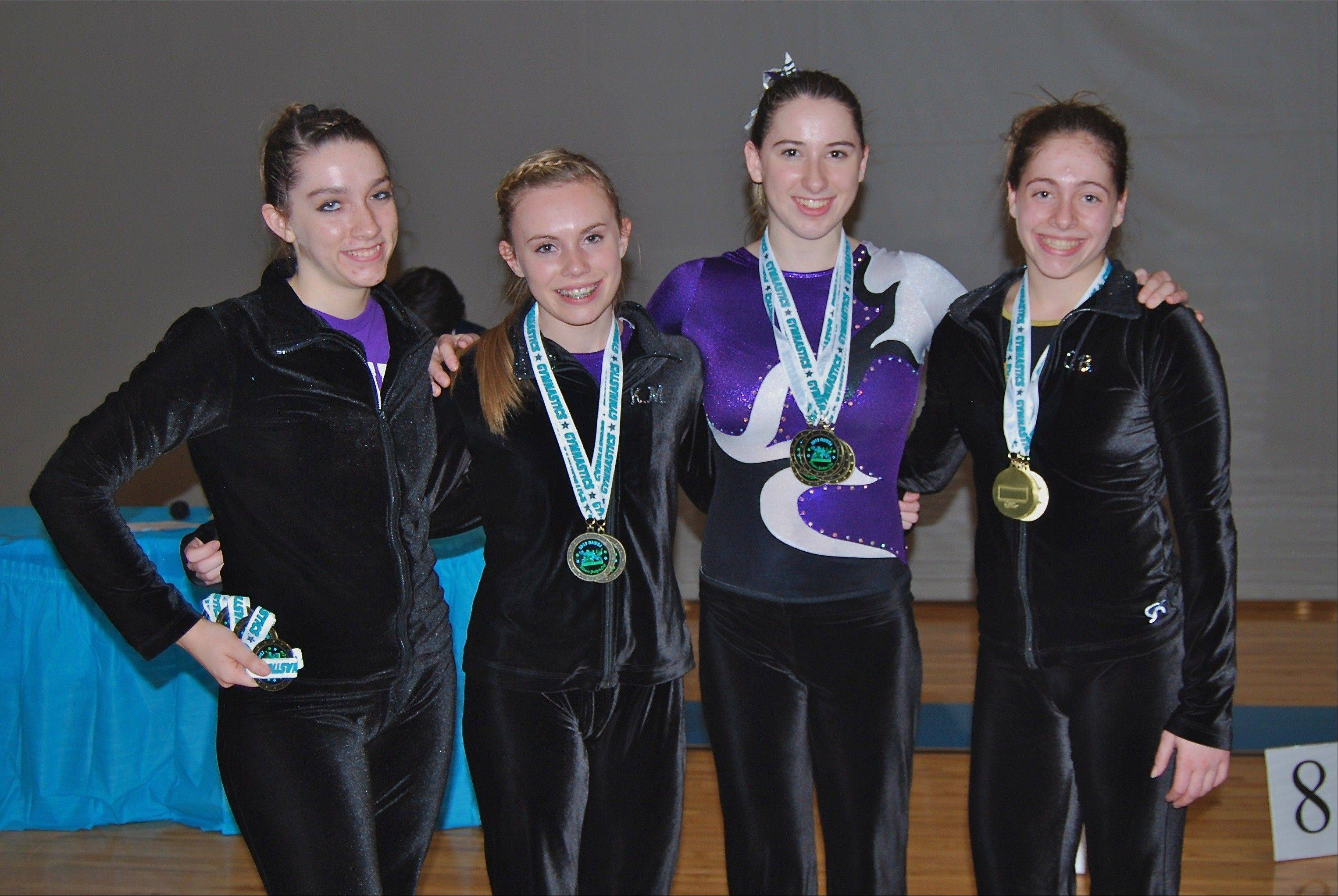 High school gymnasts, from left, Krystal Kofoed (Warren), Kyra McCue (Warren), Lauren Feely (Carmel) and Carli Betman (Glenbrook North), at the Illinois Judges Cup, held recently in Bourbonnais. The girls, who compete for Ultimate Gymnastics of Gurnee, used the opportunity to qualify for next spring's Illinois State Meet before the high school season begins. Also competing for Ultimate Gymnastics, was Lake Forest's Brittany Moccia, not pictured.