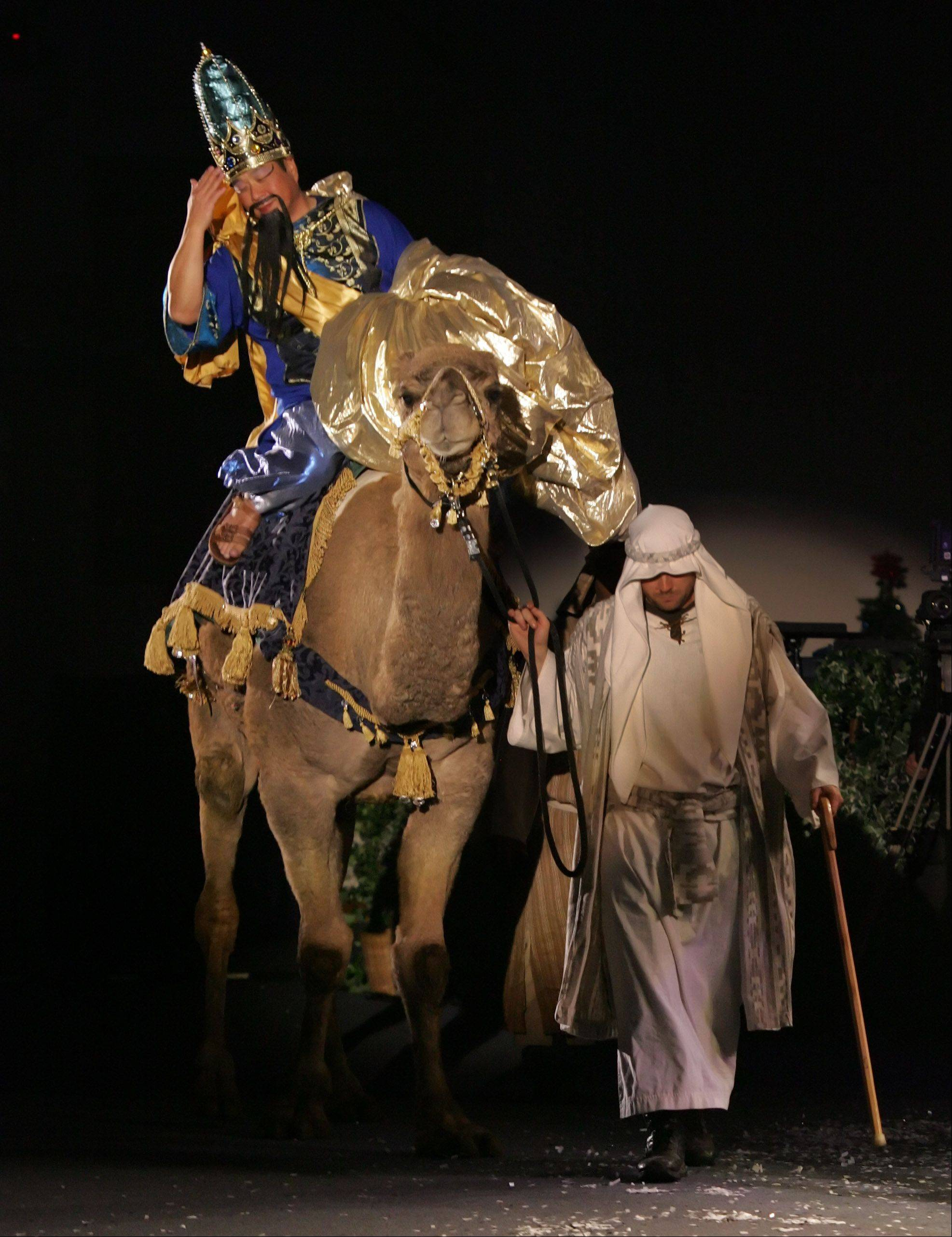"One of the Wise Men, David Kumura, arrives on a camel during the performance of last year's ""Bethlehem's Cry Heard Around The World"" pageant at Quentin Road Baptist Church in Lake Zurich."