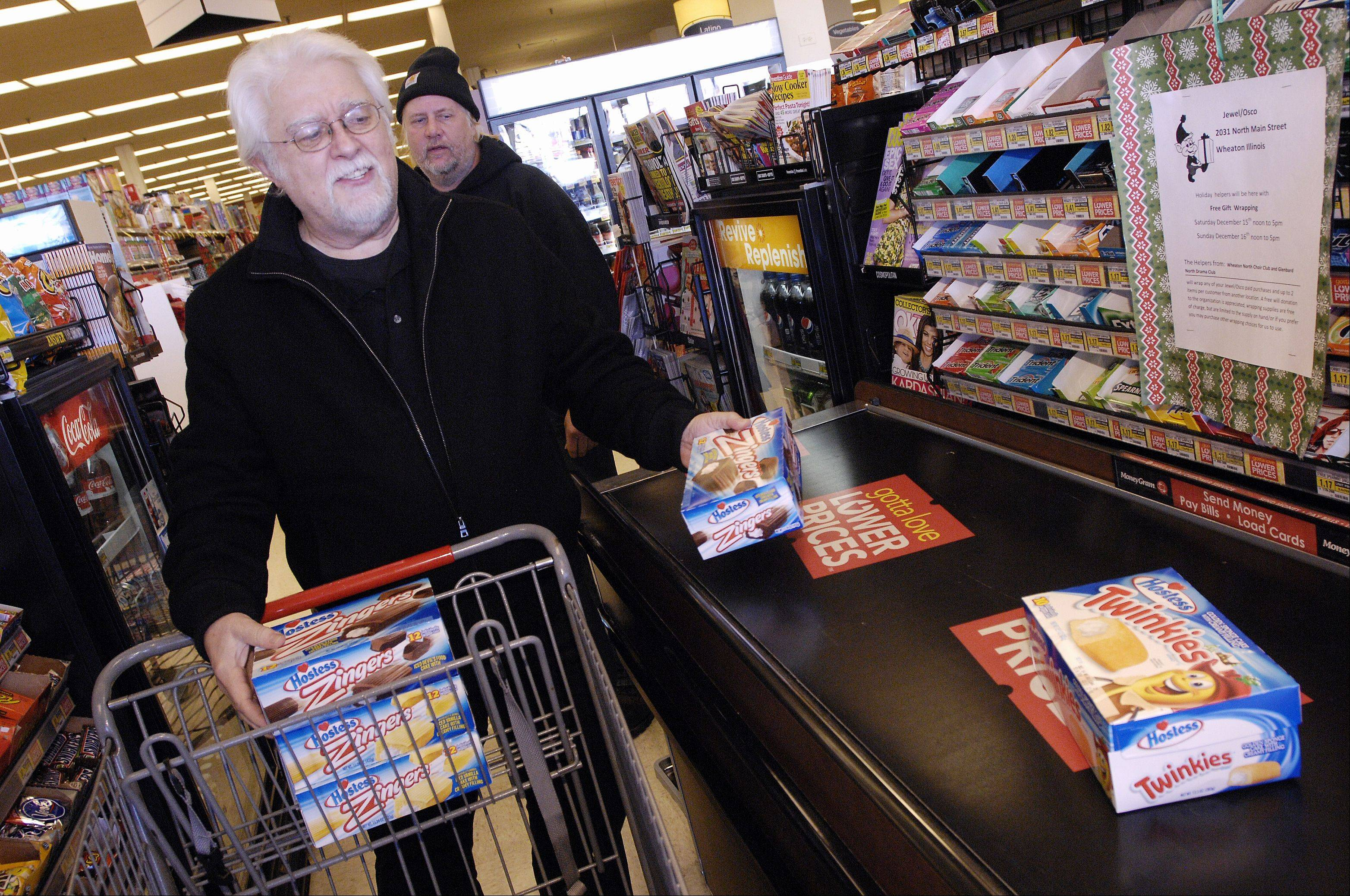 Jewel customer Bob Gunnison of Carol Stream snatched up the last of the Twinkies at the Wheaton Jewel. As of 9am Monday morning other Hostess products were still available, such as Zingers, Ding Dongs and Cup Cakes.