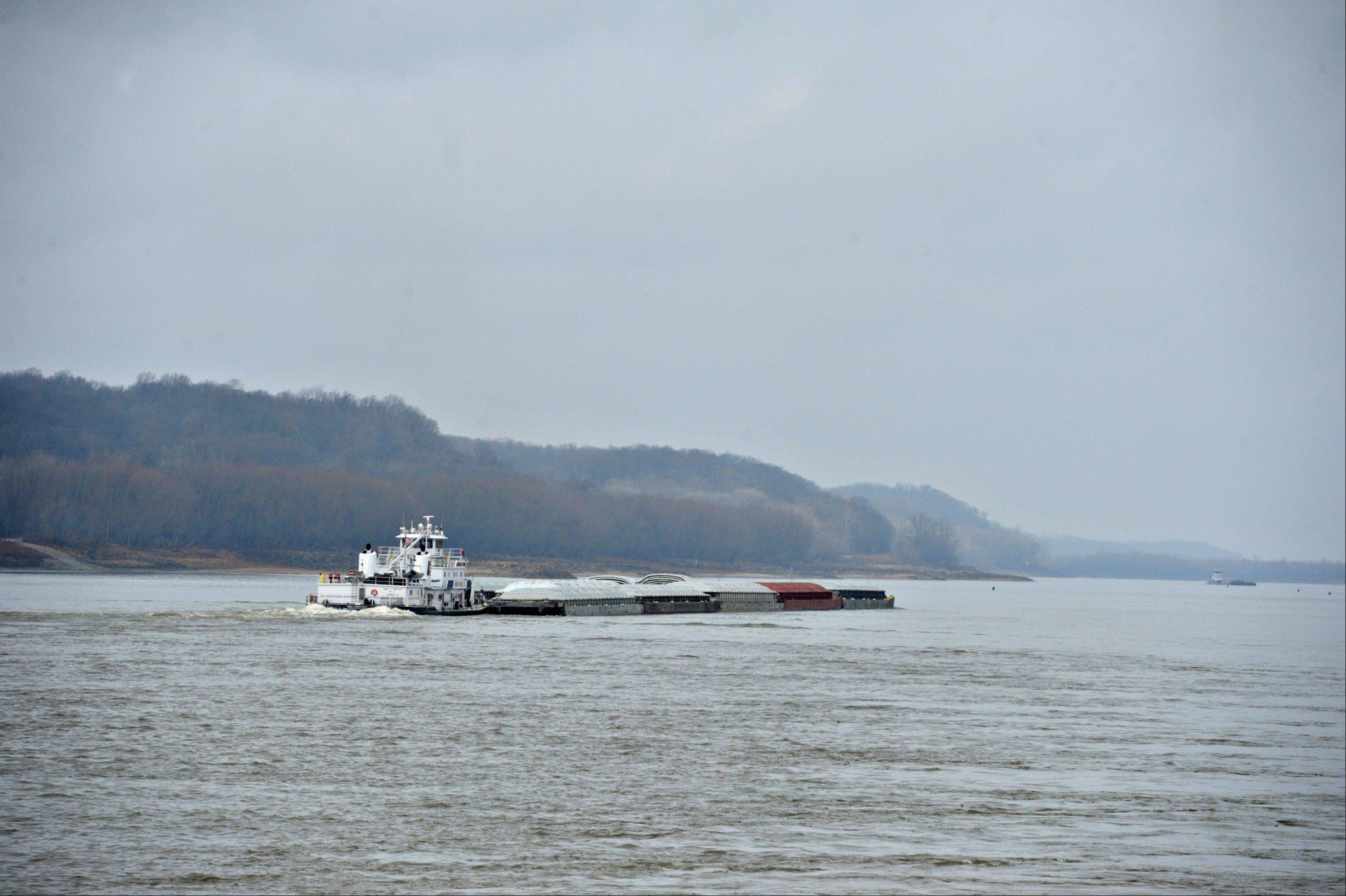 A tug boat pushes barges Friday on the Mississippi River south of St. Louis.