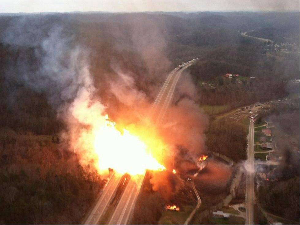 A fireball erupts Tuesday across Interstate 77 from a gasline explosion in Sissonville, W. Va.