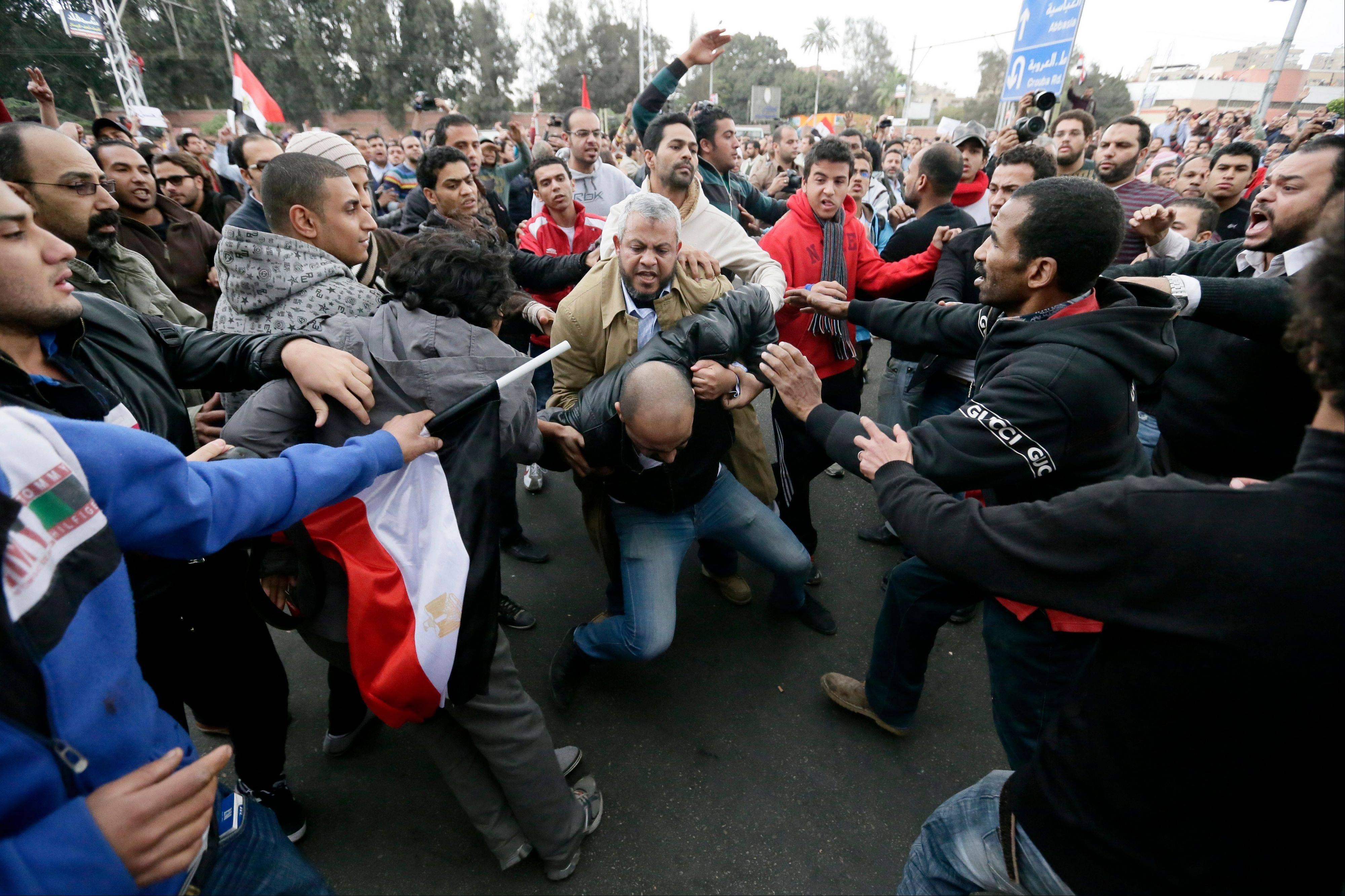 Associated Press File Photo In this Dec. 5 photo, Egyptian President Mohammed Morsi�s supporters beat an opponent, center, during clashes outside the presidential palace, in Cairo, Egypt. The scene from bloody clashes outside the presidential palace a week ago hangs over Egypt�s political crisis, as a daunting sign of how much more violent the confrontation between Morsi�s Islamist supporters and the opposition that has launched a giant wave of protests against him can become.