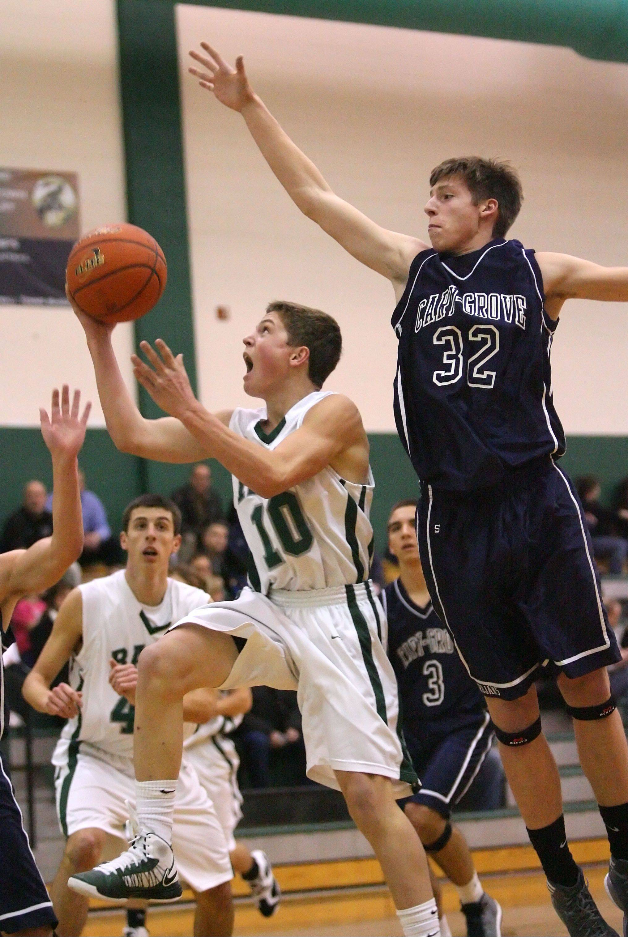 Grayslake Central�s Joey Mudd, left, drives on Cary-Grove�s Dean Lee on Tuesday night at Grayslake Central.