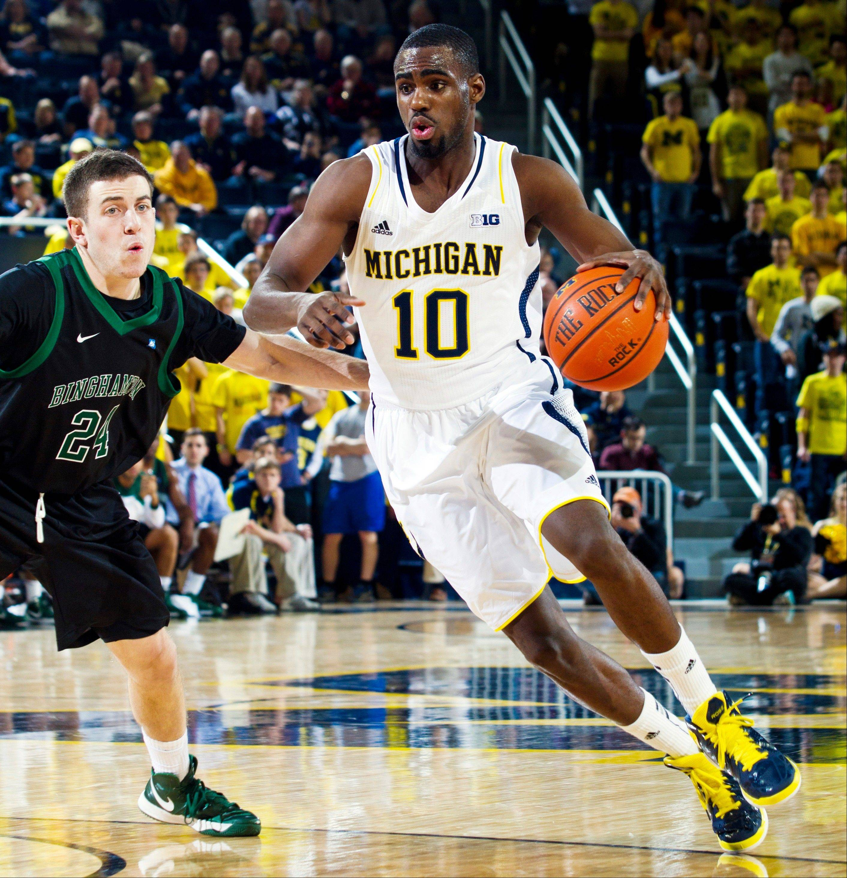 Binghamton guard Mike Horn defends against Michigan guard Tim Hardaway Jr., Tuesday during the second half at Crisler Center in Ann Arbor, Mich. Michigan won 67-39.