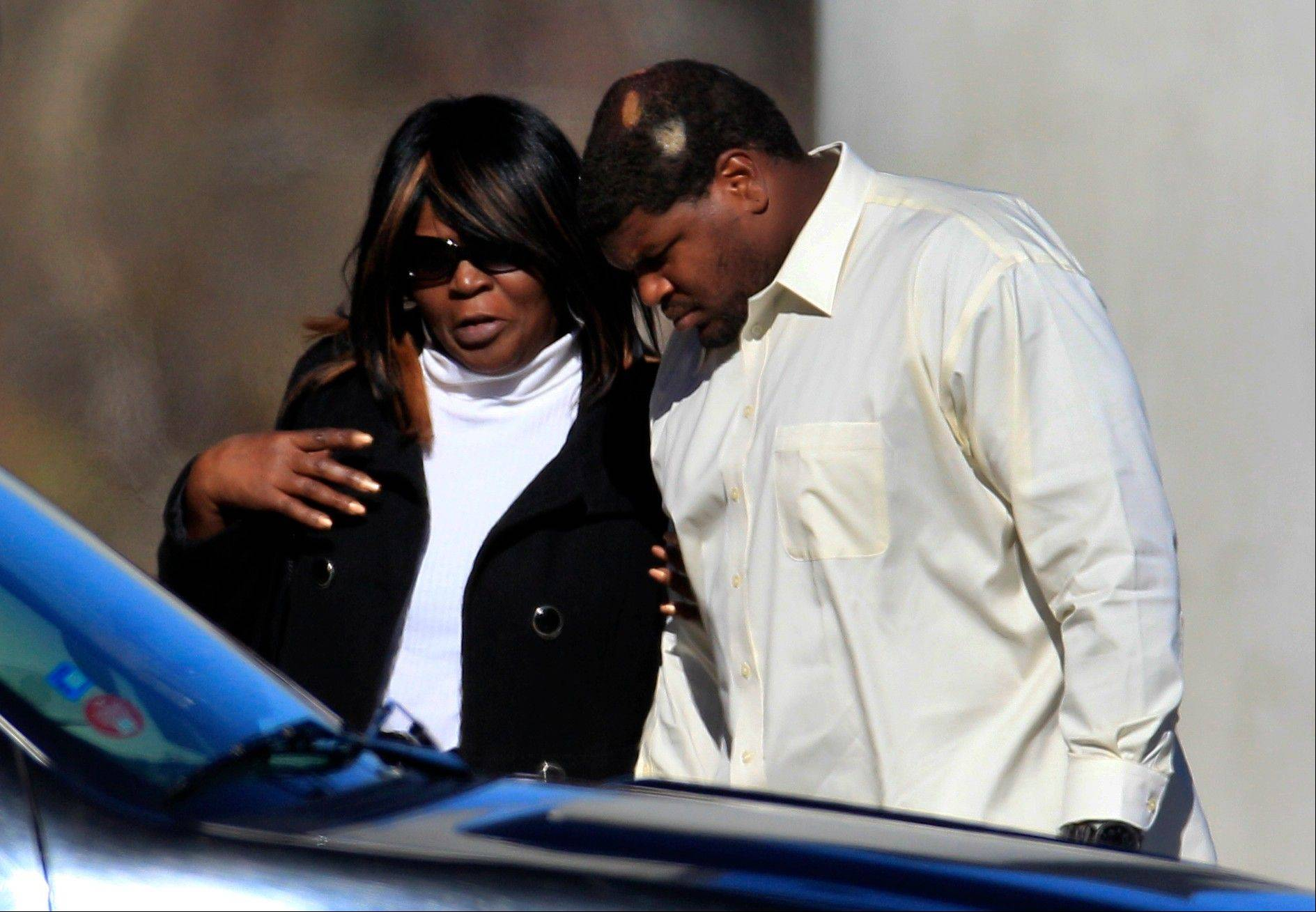 Dallas Cowboys football player Josh Brent, right, arrives embracing an unidentified person Tuesday at a memorial service for teammate Jerry Brown at Oak Cliff Bible Fellowship education center in Dallas. Brown died in a suspected drunken-driving accident on Saturday. Brent was the driver and is charged with intoxication manslaughter.