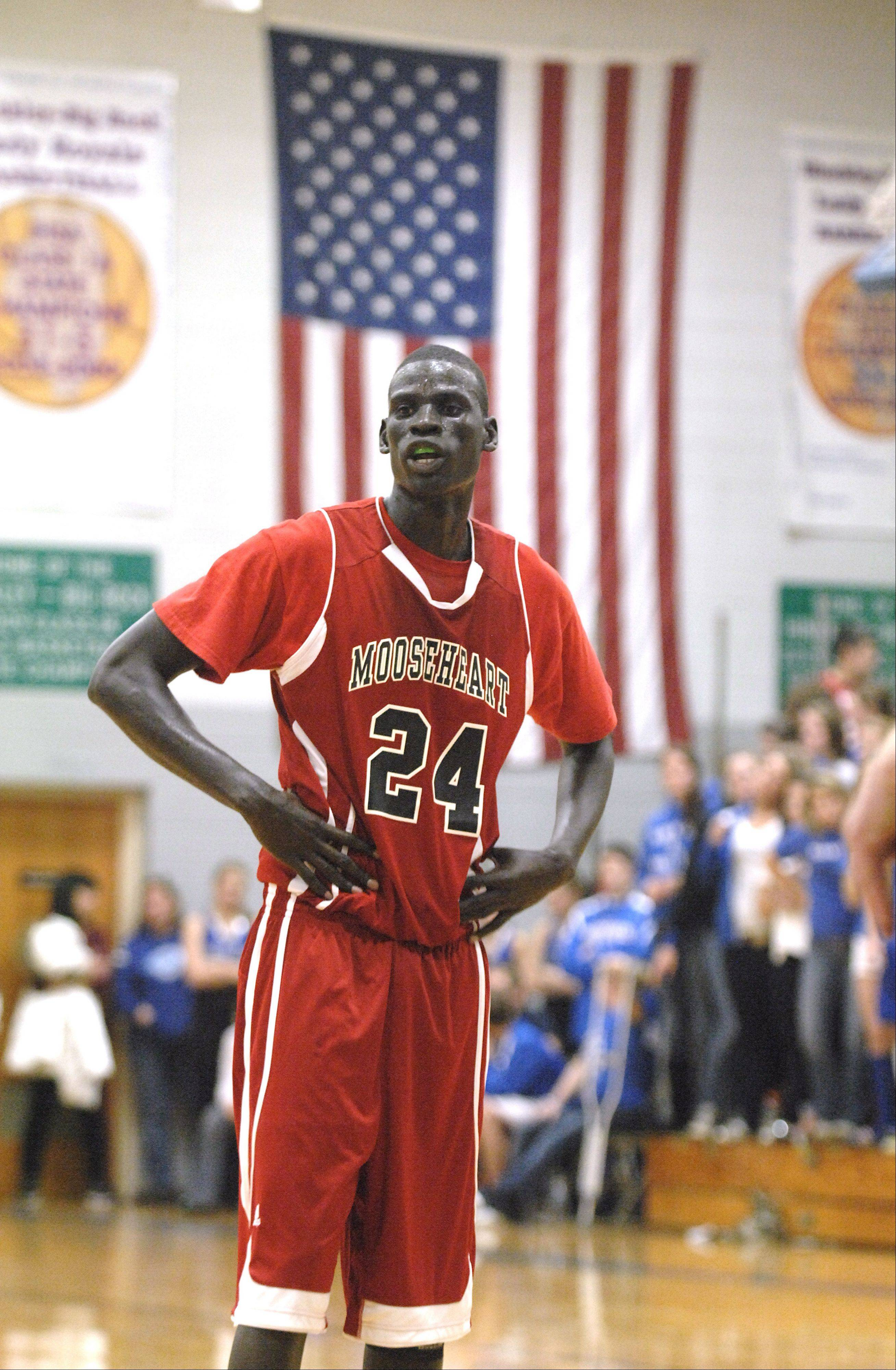 Mooseheart�s Mangisto Deng waits for the ball at the free throw line in the second half against Hinckley-Big Rock. On Monday, Deng and his teammates found out good news from the IHSA.
