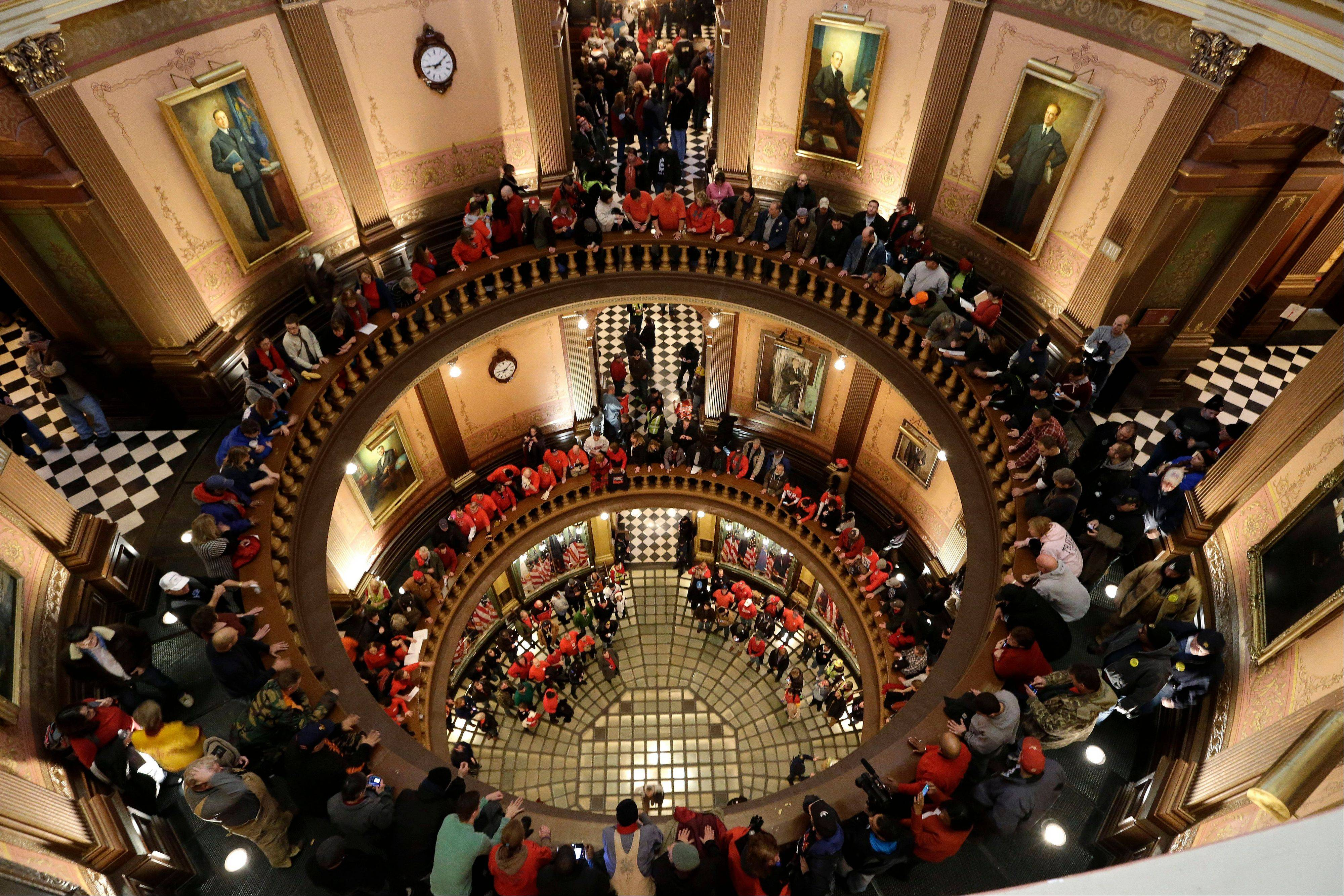 Protesters gather for a rally in the State Capitol rotunda in Lansing, Mich., Tuesday, Dec. 11, 2012. The crowd is protesting right-to-work legislation passed last week.