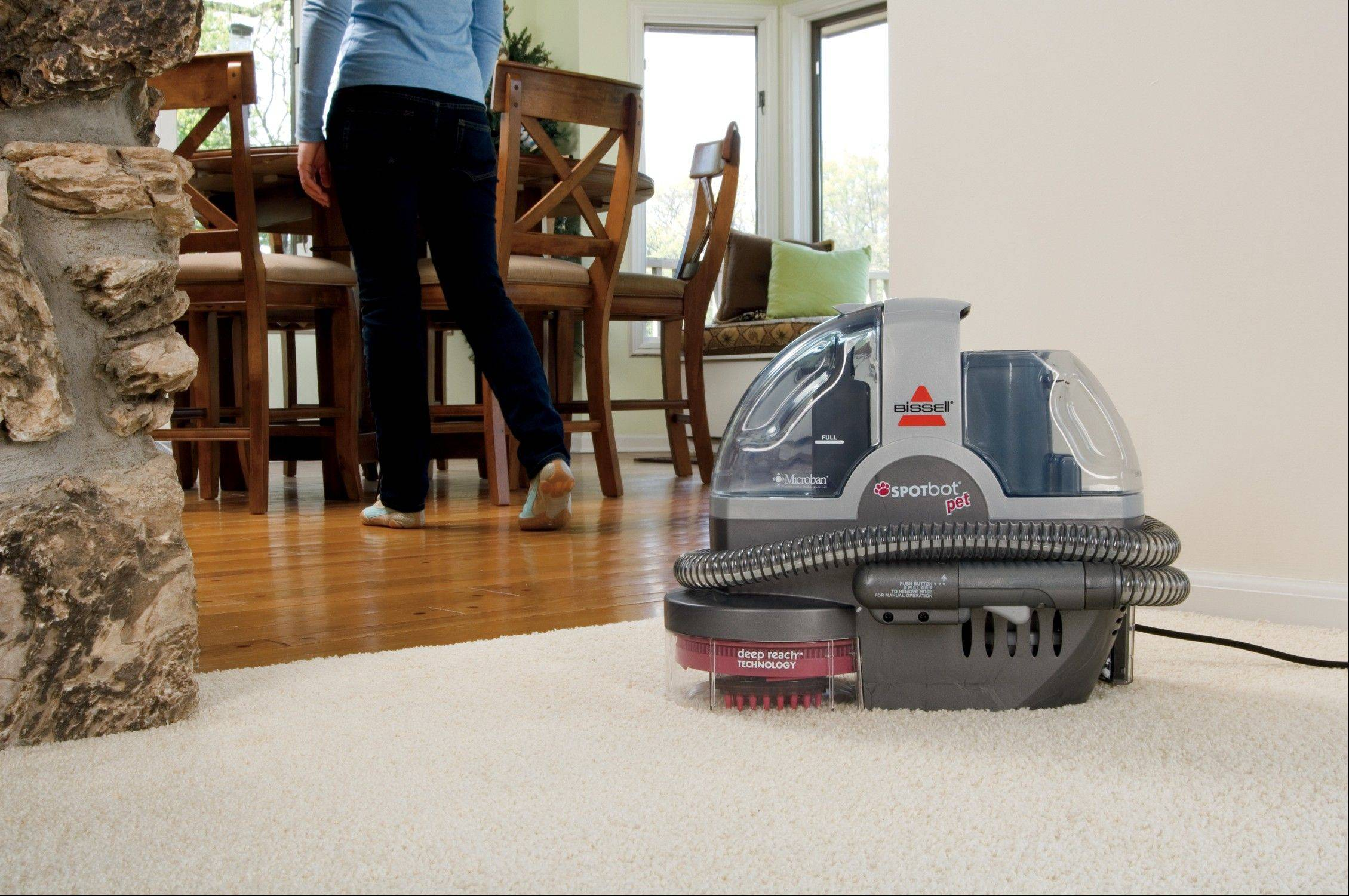 A BISSELL SpotBot Pet, a hands-free, portable deep carpet shampooer that permanently removes pet stains.
