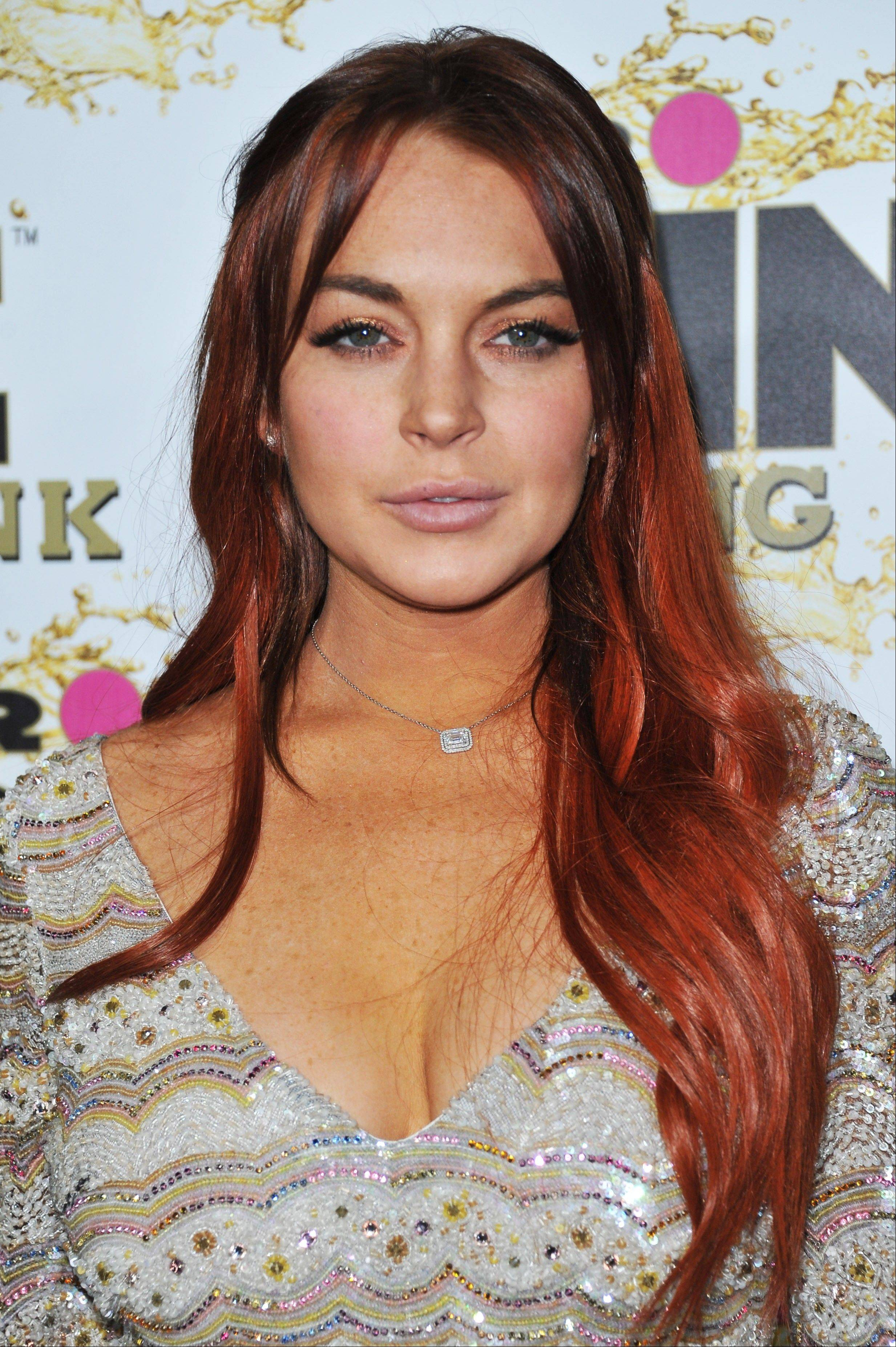 Lindsay Lohan is due to be arraigned on Wednesday on three misdemeanor charges filed after authorities say they determined the actress lied about being a passenger when her Porsche slammed into the back of a dump truck in June.