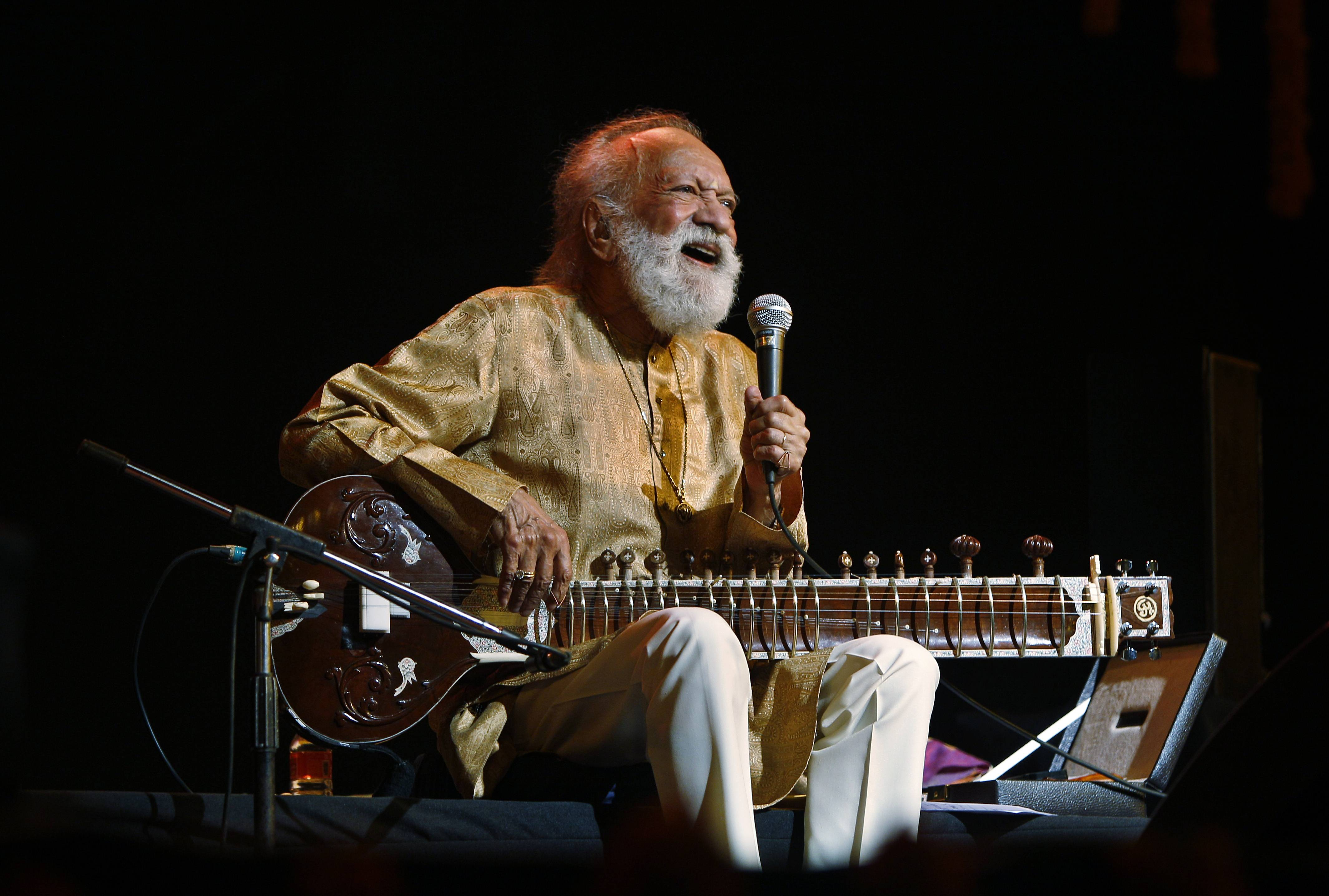 Indian musician and sitar maestro Pandit Ravi Shankar, 92, performs during a concert in Bangalore, India. Shankar, the sitar virtuoso who became a hippie musical icon of the 1960s after hobnobbing with the Beatles and who introduced traditional Indian ragas to Western audiences over an eight-decade career, died Tuesday. He was 92.
