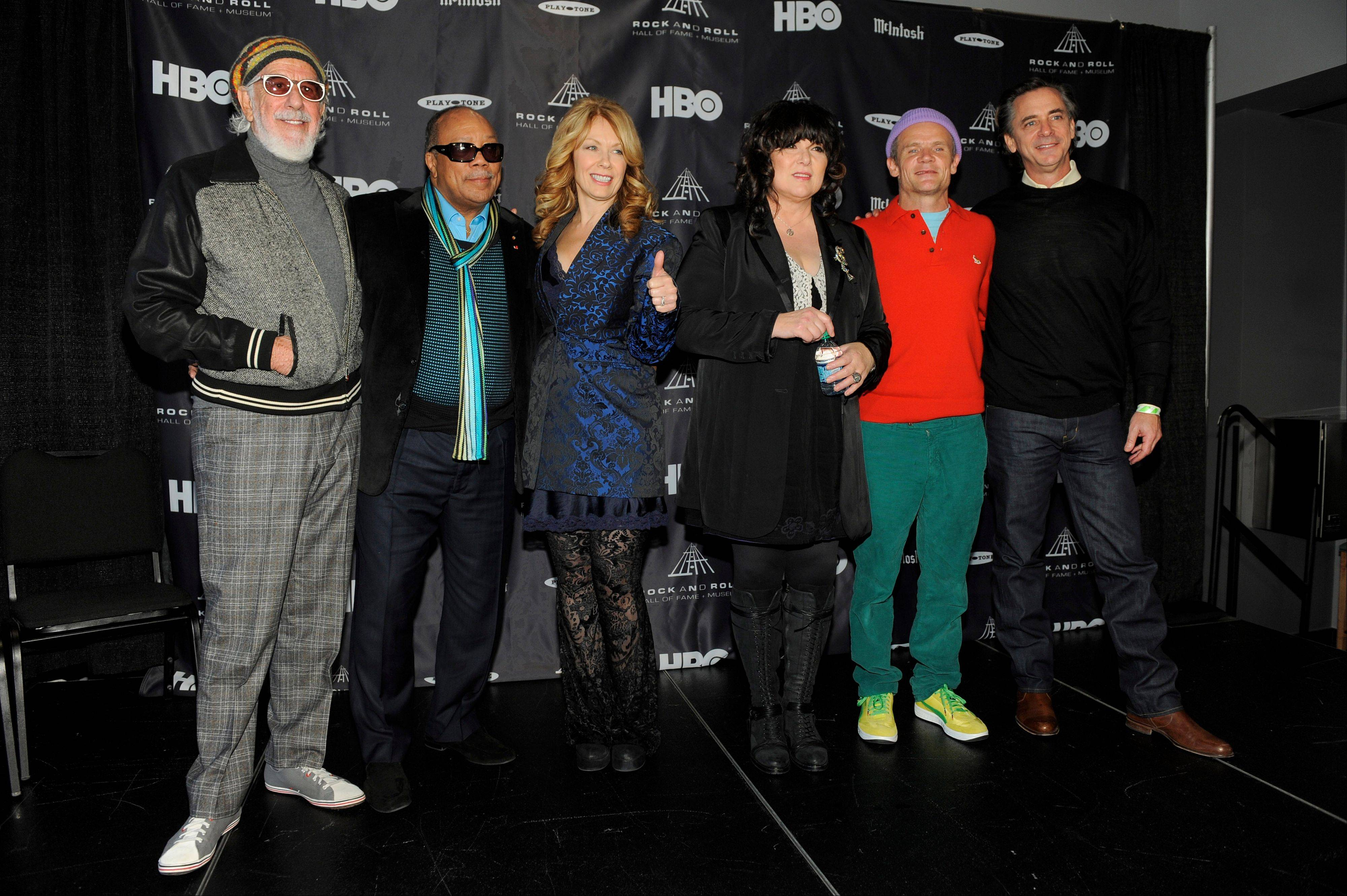 Rock and Roll Hall of Fame inductees, from left, Lou Adler, Quincy Jones and Nancy and Ann Wilson of Heart pose with 2012 inductee Flea, second from right, and Rock and Roll Hall of Fame President and CEO Joel Peresman Tuesday at a news conference to announce the 2013 inductees in Los Angeles. The 28th Annual Rock and Roll Hall of Fame Induction Ceremony will be held at the Nokia Theatre L.A. Live in Los Angeles on April 18, 2013.