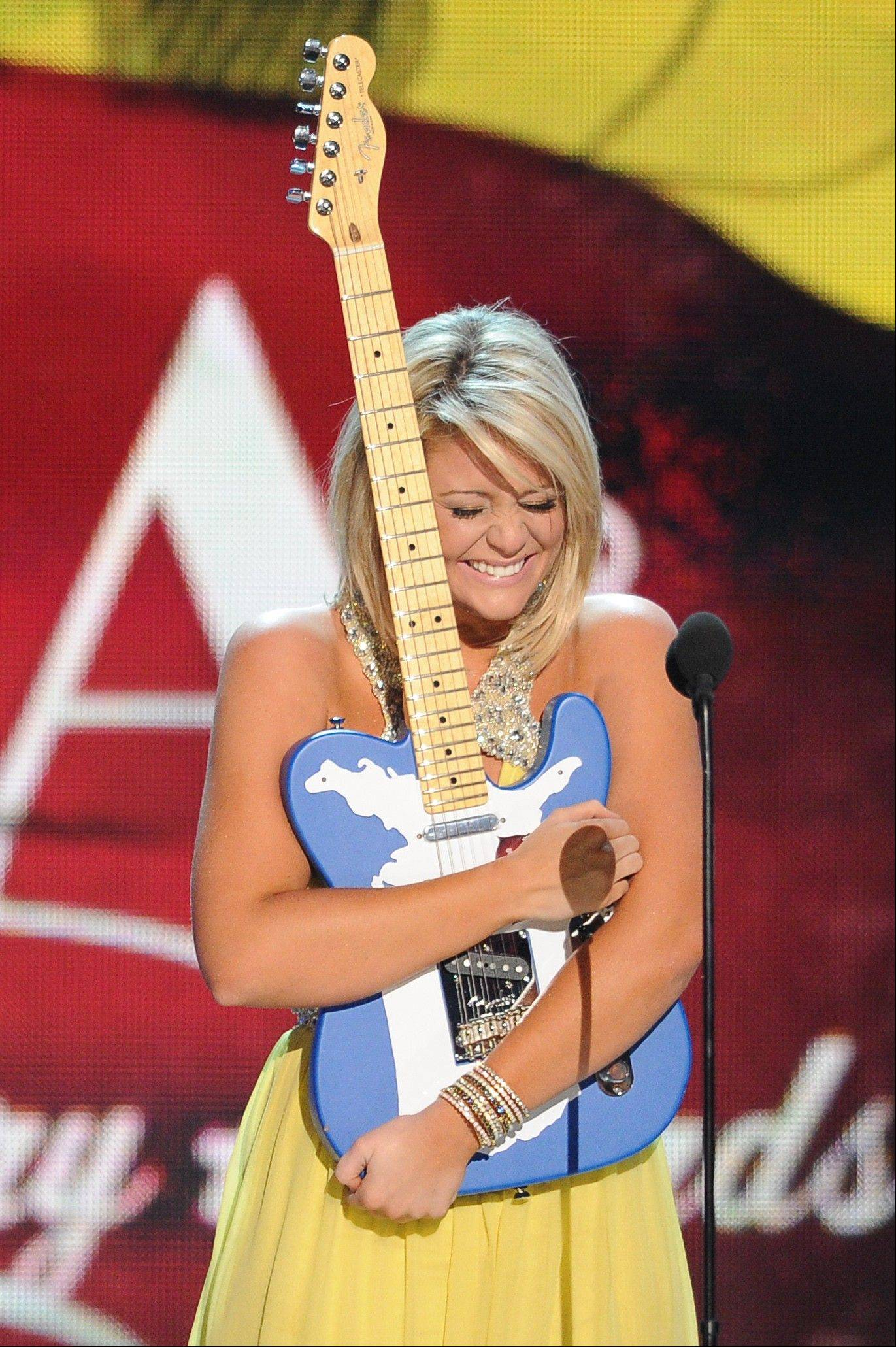 Lauren Alaina accepts the award for New Artist of the Year during the American Country Awards on Monday.