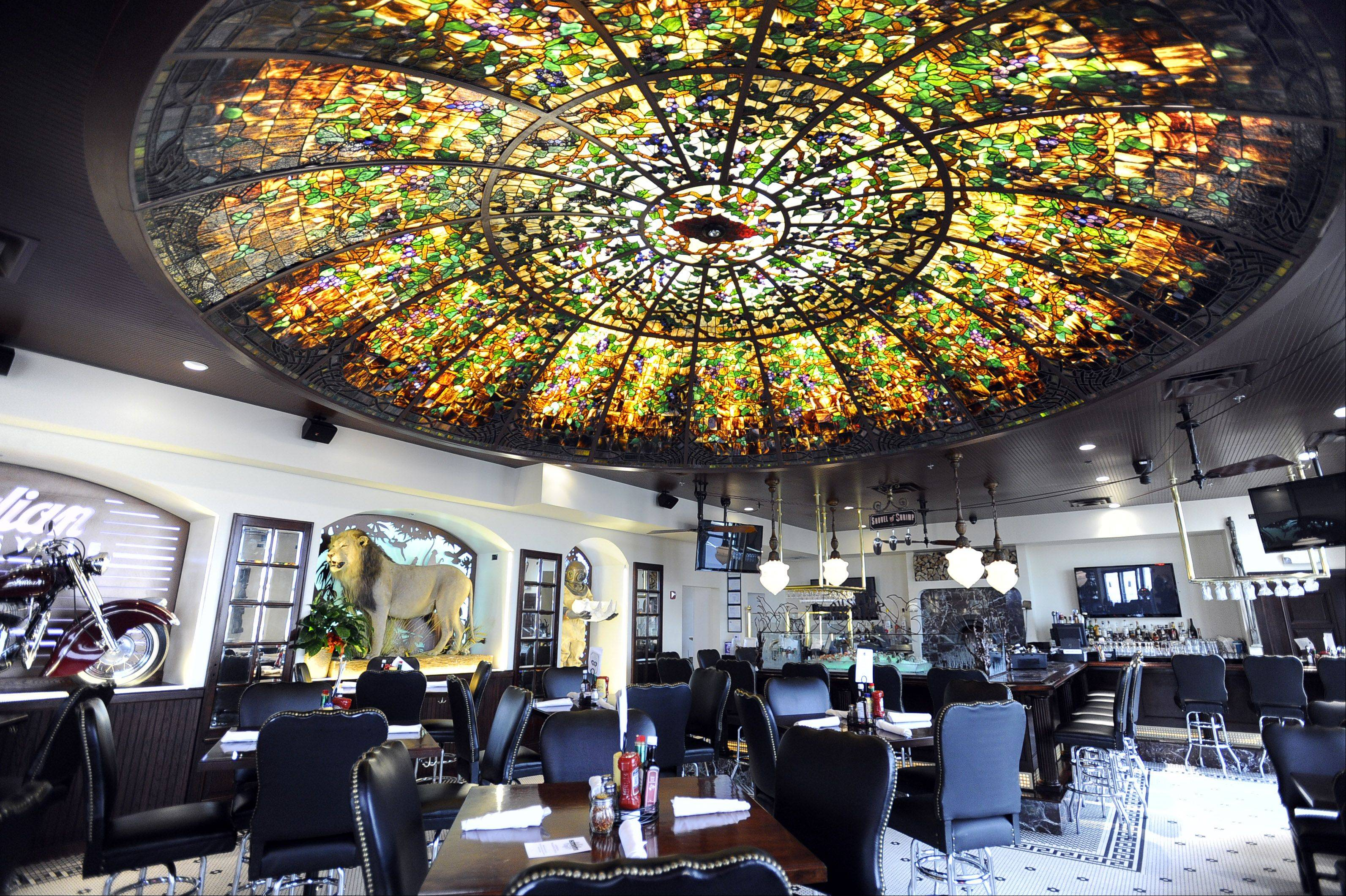 The monumental stained glass ceiling circa 1915 is breath-taking in the main dining room at the Stone Eagle Tavern in Hoffman Estates.