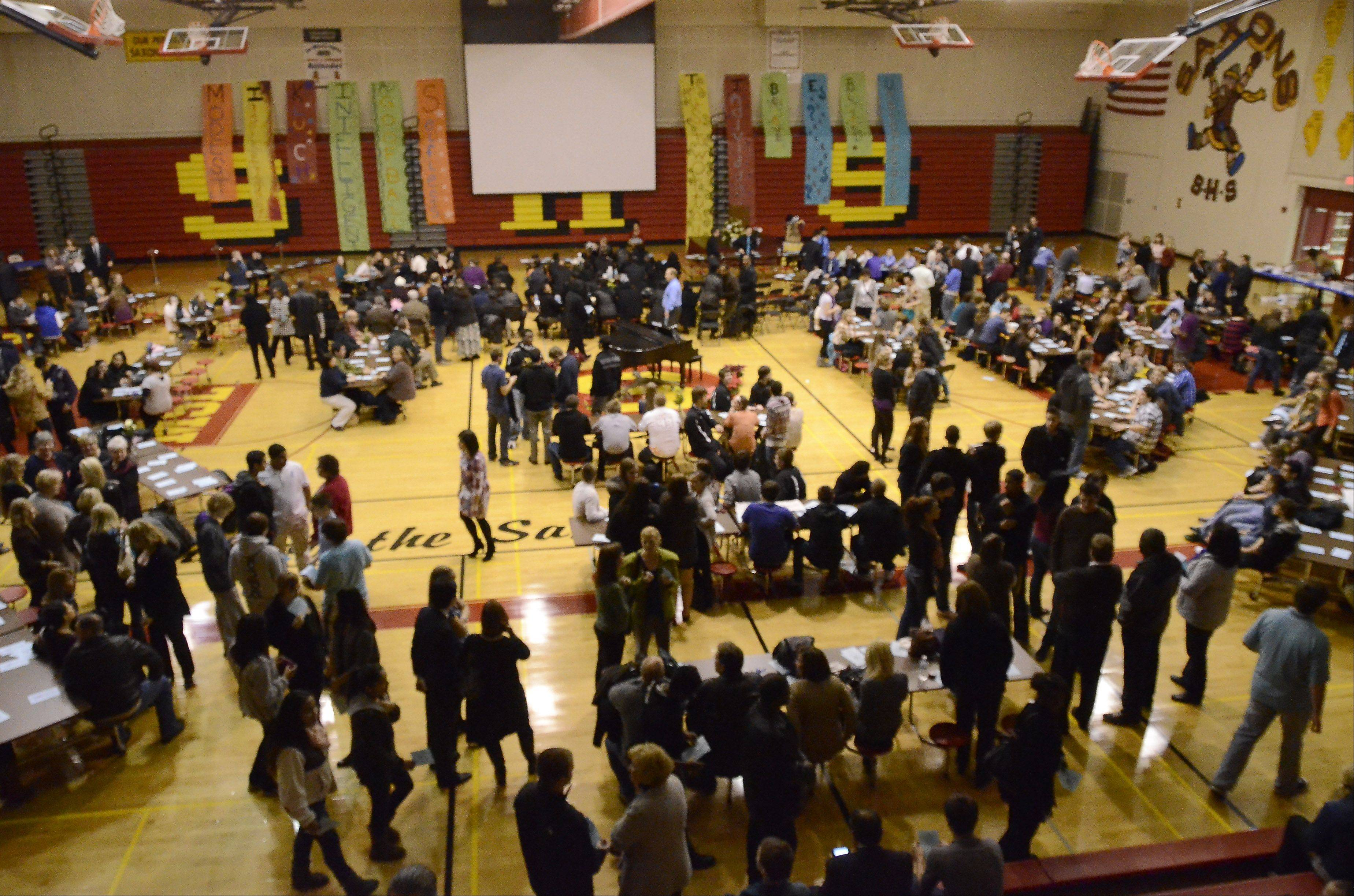 The Schaumburg High School gym fills with family and classmates of student Mikias Tibebu at a memorial service in his honor Thursday night.