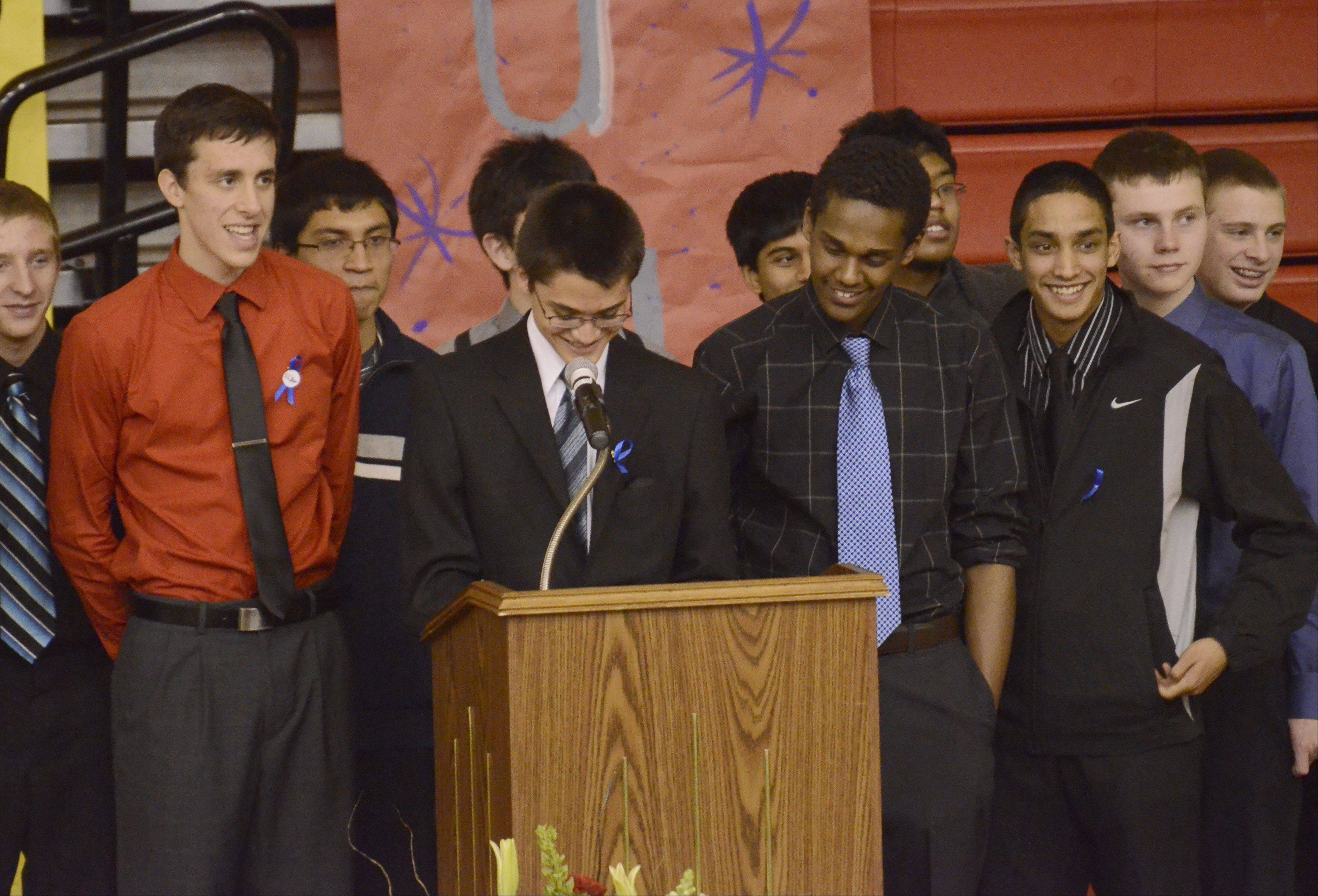 Stephen Piller talks about the fun times with his friend Mikias Tibebu, a Schaumburg student who was killed by a hit-and-run driver. Standing to the right of Piller are Mikias' brother Nebeyu Tibebu and members of the cross country team.