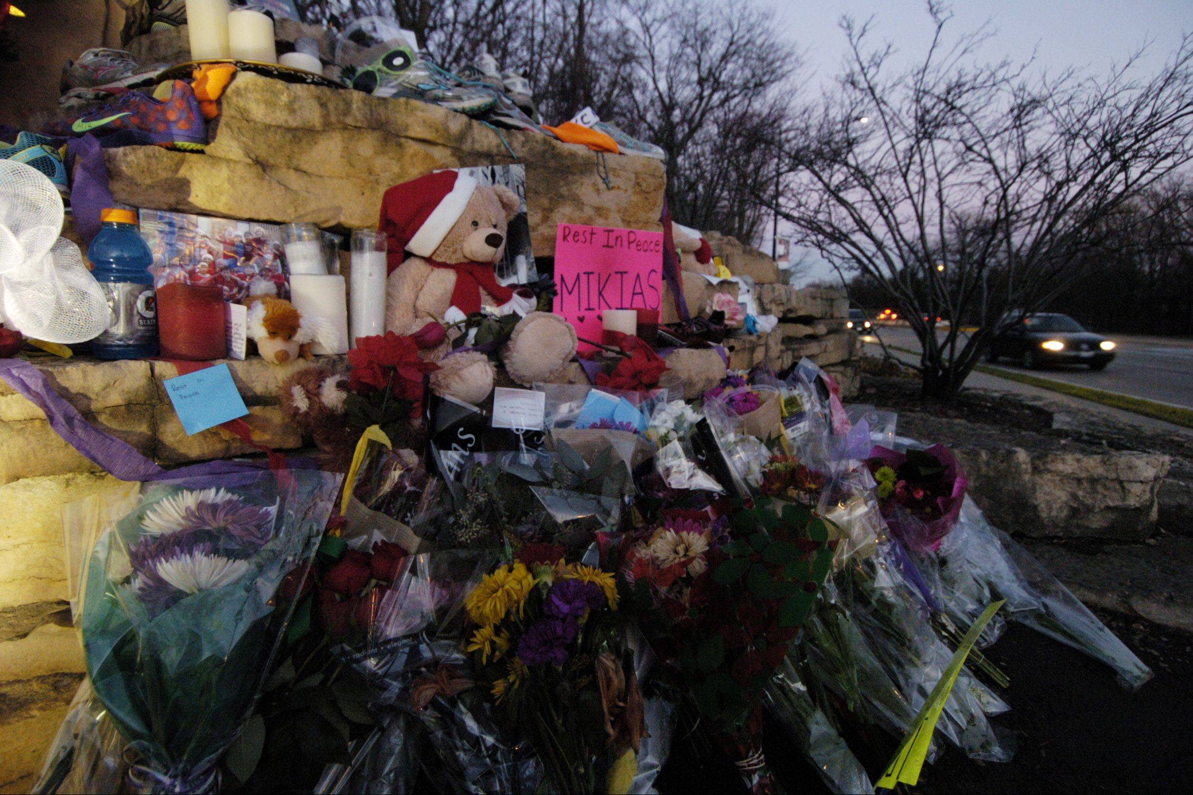 A roadside memorial honoring Schaumburg High School Senior Mikias Tibebu has been set up at the intersection of Branchwood Drive and Schaumburg Road, where he was struck by a hit-and-run driver last weekend.